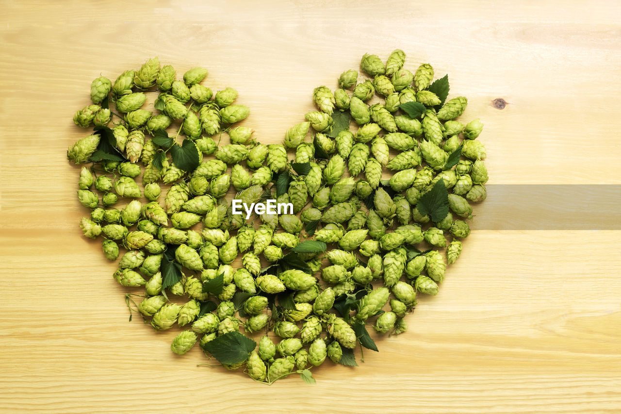 High Angle View Of Hops Arranged As Heart Shape On Table