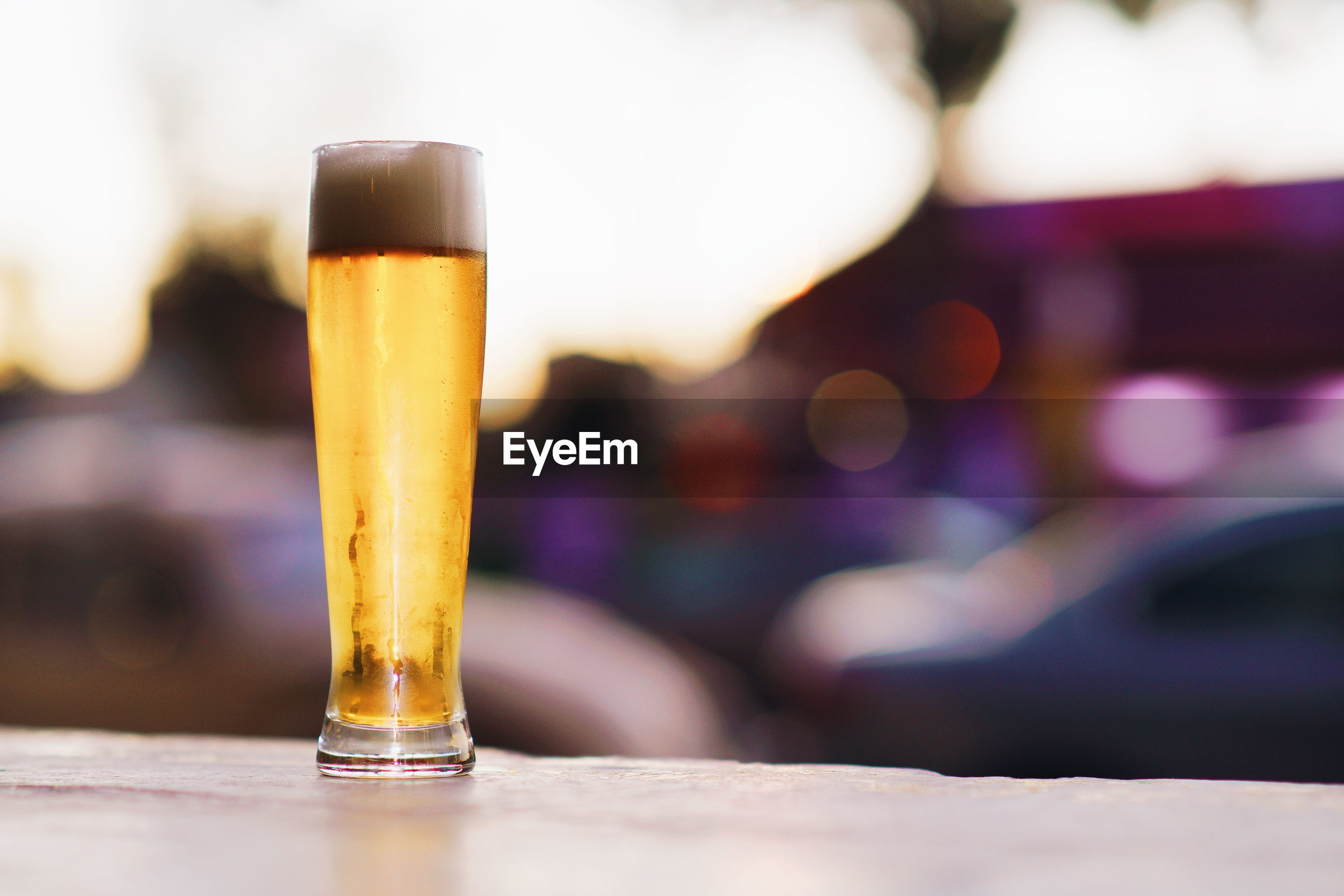 CLOSE-UP OF BEER ON TABLE