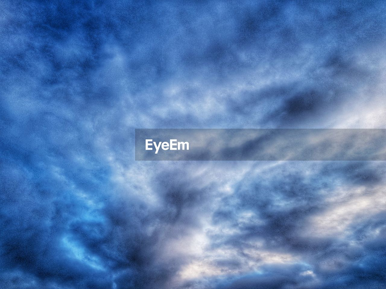 cloud - sky, sky, beauty in nature, low angle view, blue, tranquility, no people, nature, tranquil scene, scenics - nature, backgrounds, outdoors, dramatic sky, day, overcast, cloudscape, storm, idyllic, full frame, meteorology