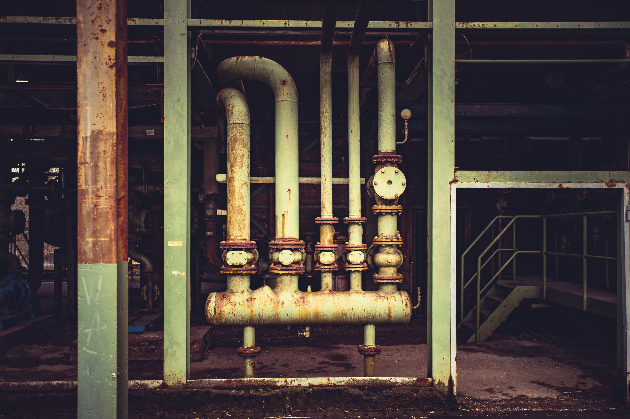 Old rusty metallic pipes in industry