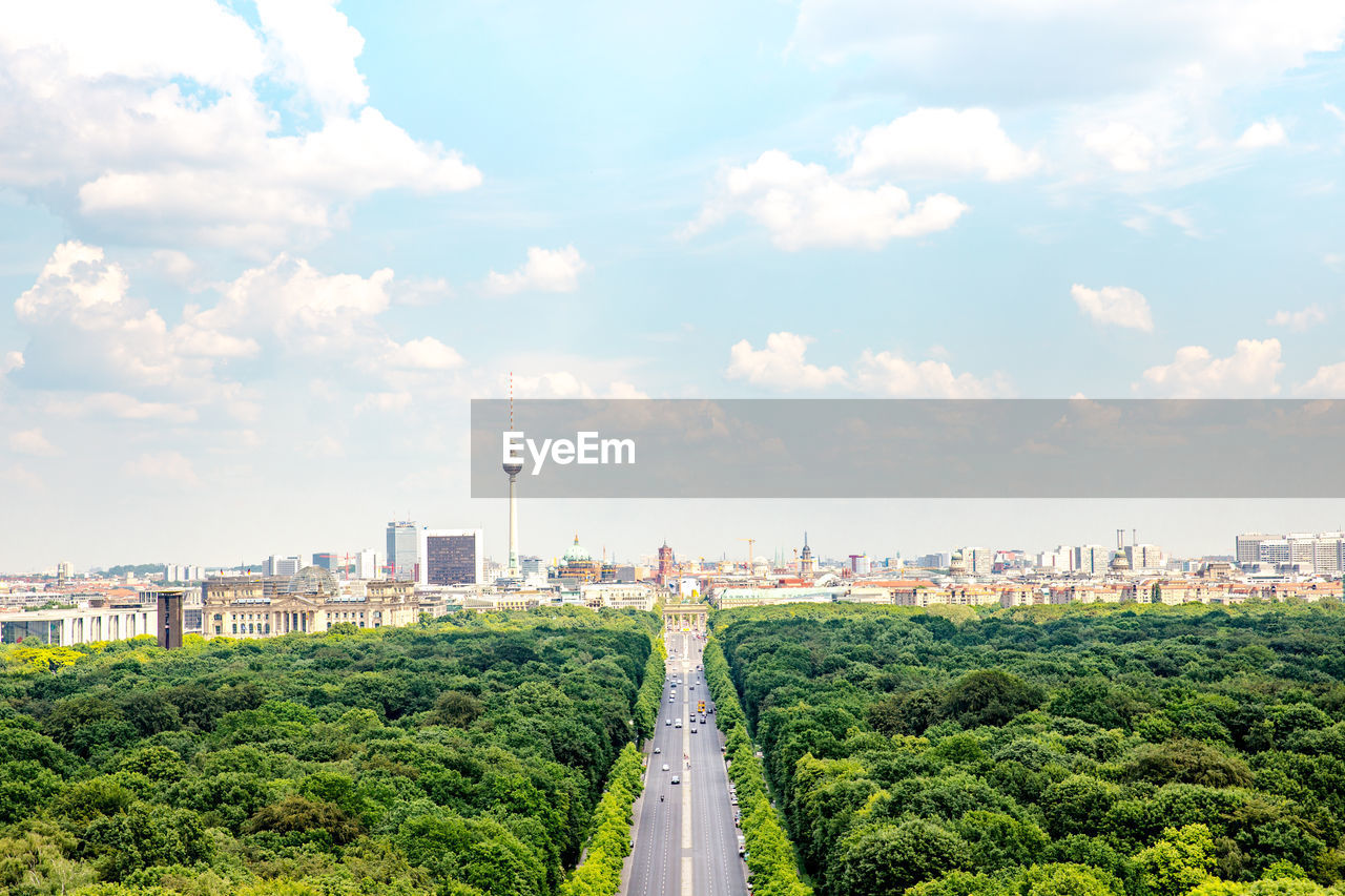 Aerial View Of Forest In City Against Sky