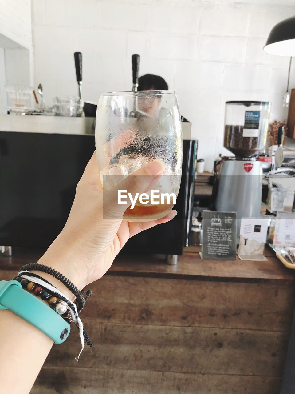 human hand, real people, one person, drink, hand, food and drink, household equipment, holding, refreshment, human body part, glass, lifestyles, focus on foreground, drinking glass, indoors, freshness, close-up, women, alcohol, finger