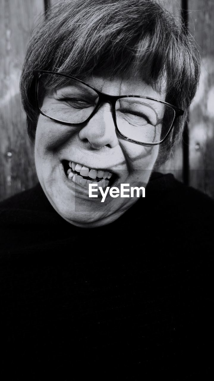 Close-up portrait of smiling mature woman