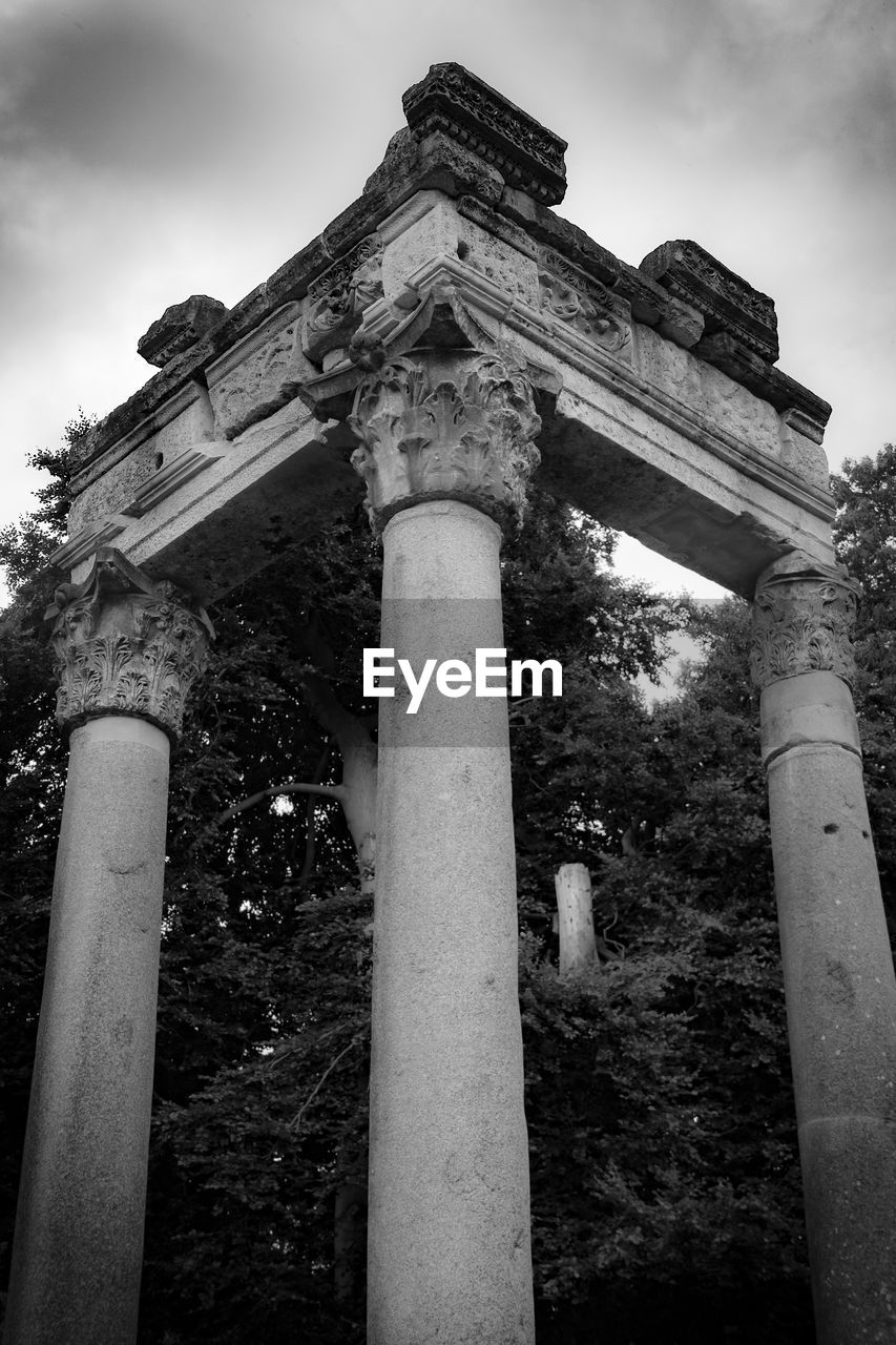 architecture, architectural column, low angle view, sky, history, built structure, the past, no people, nature, ancient, building exterior, travel destinations, day, religion, old ruin, tourism, belief, plant, spirituality, place of worship, outdoors, ancient civilization, archaeology, ruined