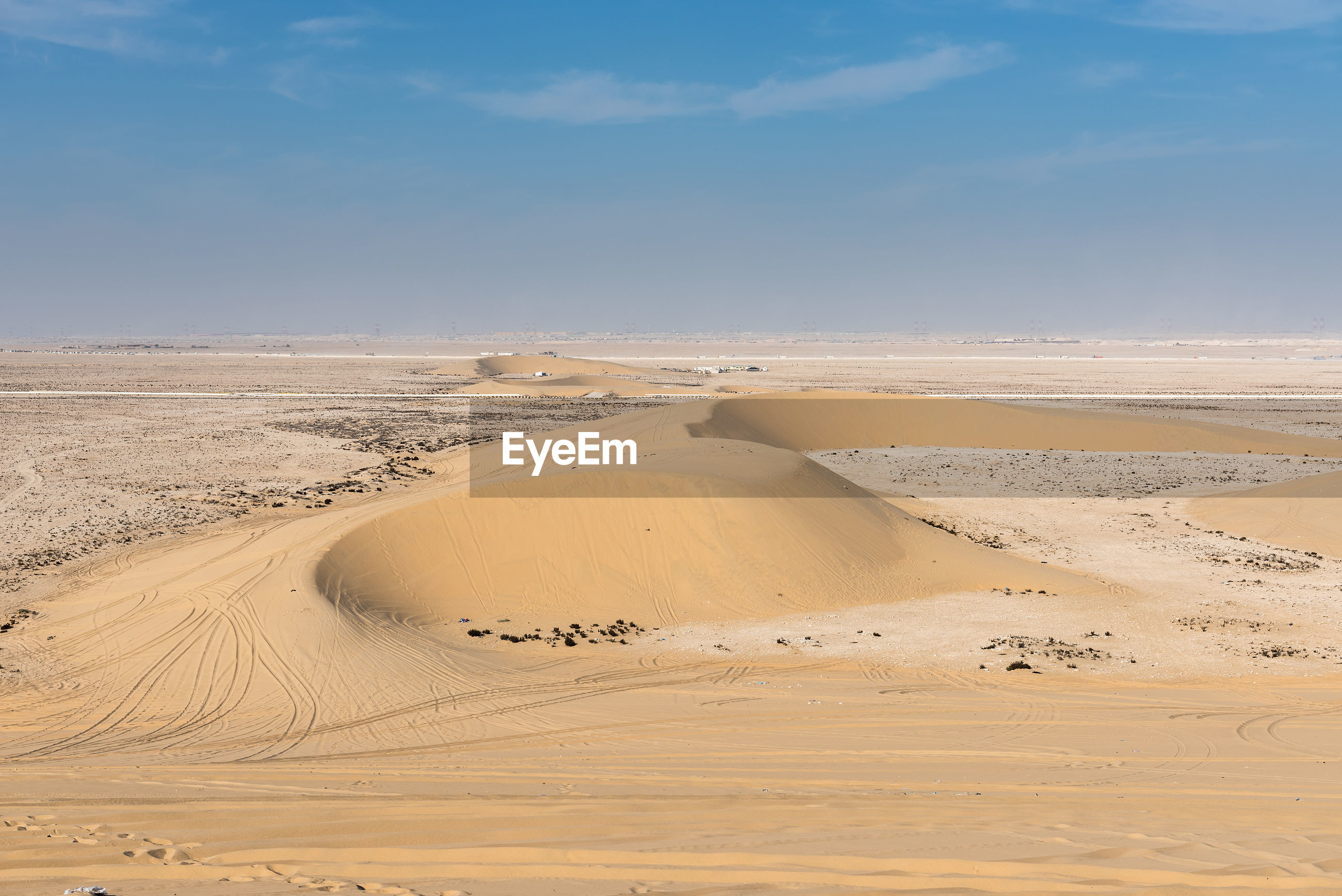 SAND DUNES AGAINST SKY