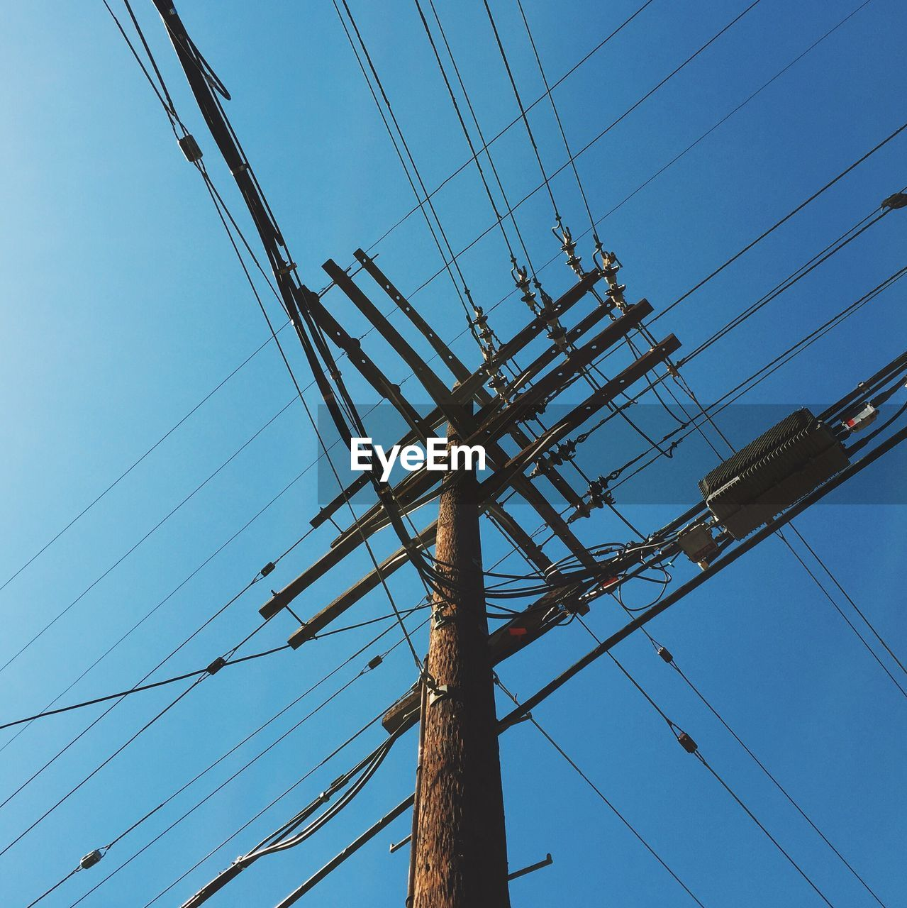 cable, connection, power supply, low angle view, power line, electricity, technology, fuel and power generation, electricity pylon, day, complexity, no people, blue, outdoors, sky, telephone line, clear sky