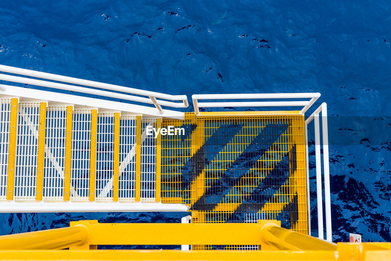 Directly Above Shot Of Offshore Platform In Sea
