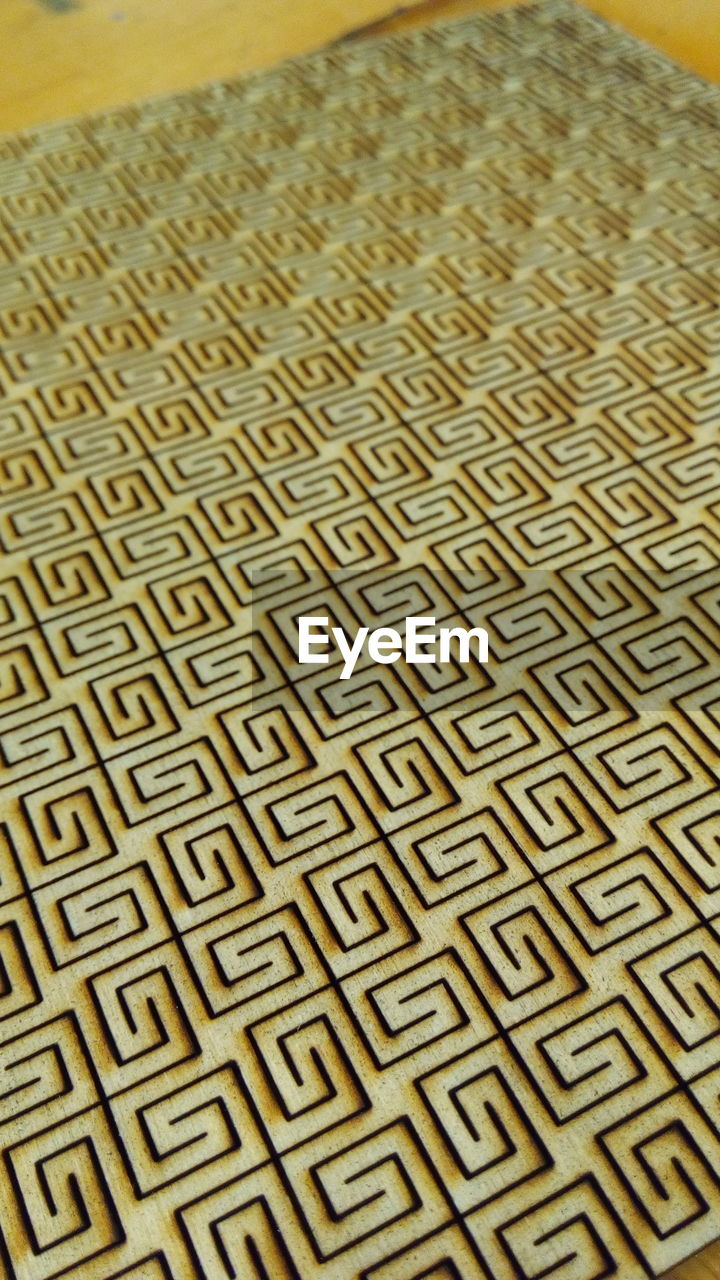 High Angle View Of Patterned Plywood On Table