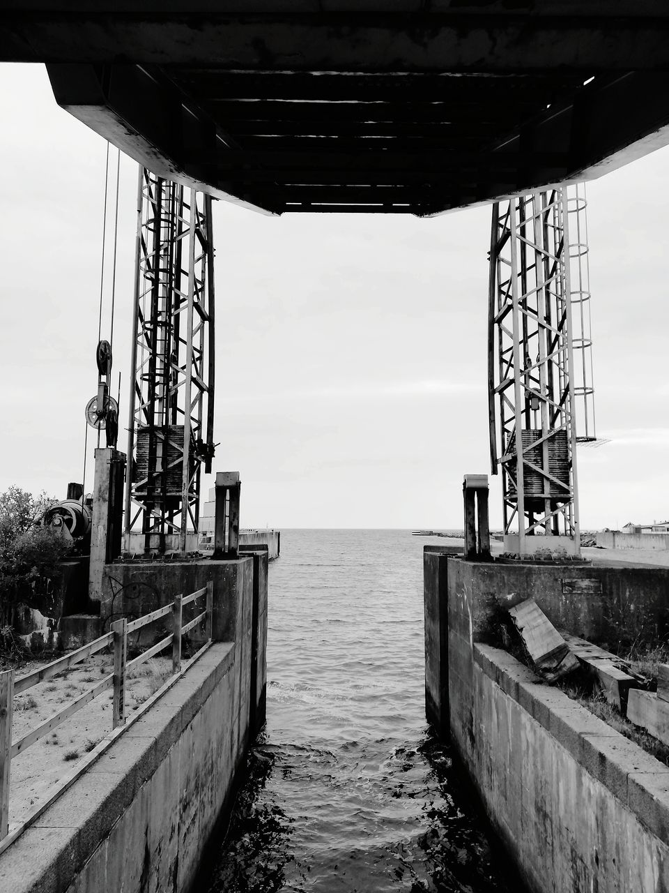 sky, water, architecture, built structure, nature, metal, sea, day, no people, outdoors, industry, connection, bridge, pier, transportation, bridge - man made structure, cloud - sky, waterfront