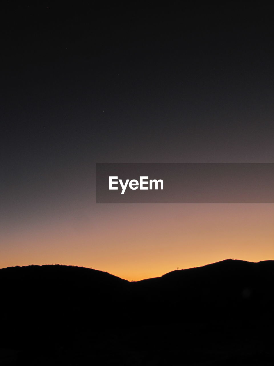 silhouette, sky, beauty in nature, tranquility, tranquil scene, copy space, scenics - nature, sunset, mountain, nature, environment, clear sky, idyllic, orange color, no people, landscape, outdoors, non-urban scene, dark, mountain range