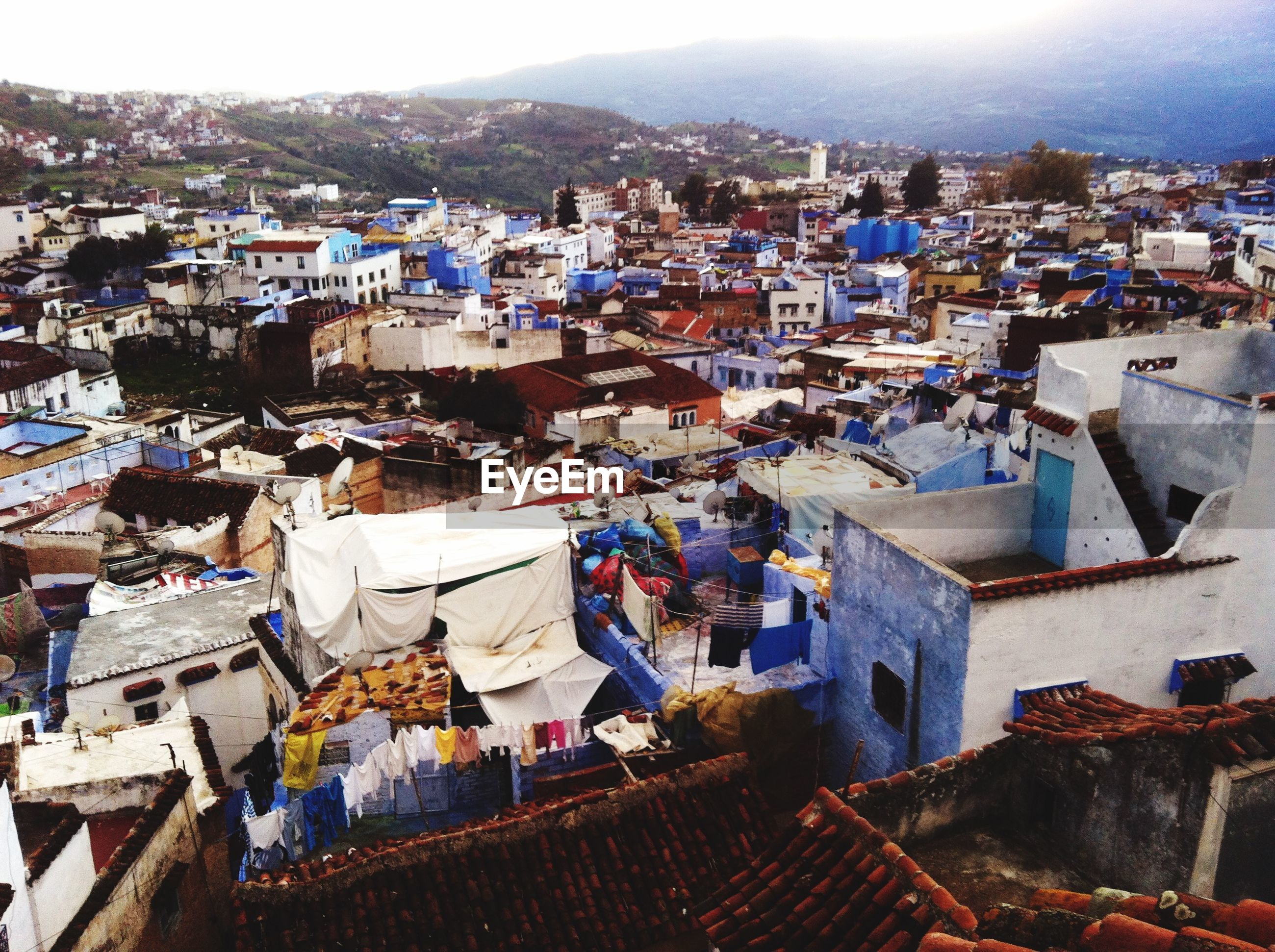 building exterior, architecture, built structure, residential district, residential structure, house, townscape, crowded, residential building, town, high angle view, roof, cityscape, city, community, human settlement, rooftop, housing settlement, sky, day