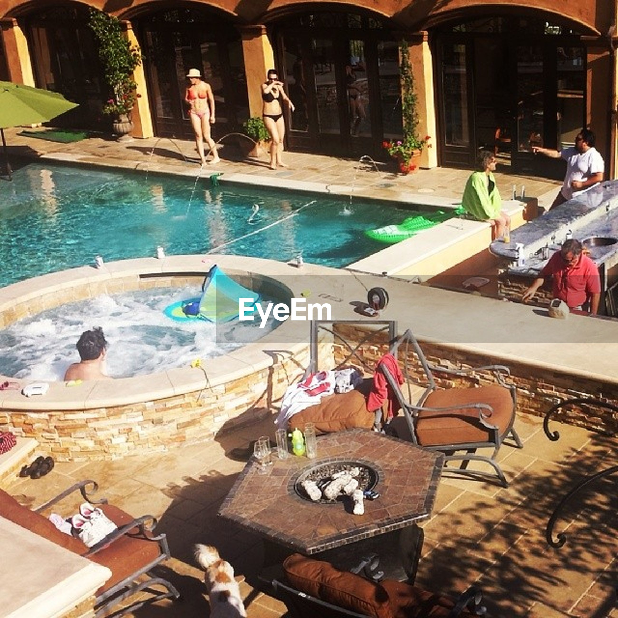 built structure, lifestyles, architecture, leisure activity, water, building exterior, high angle view, men, person, large group of people, animal themes, swimming pool, sitting, outdoors, relaxation, day, bird, city