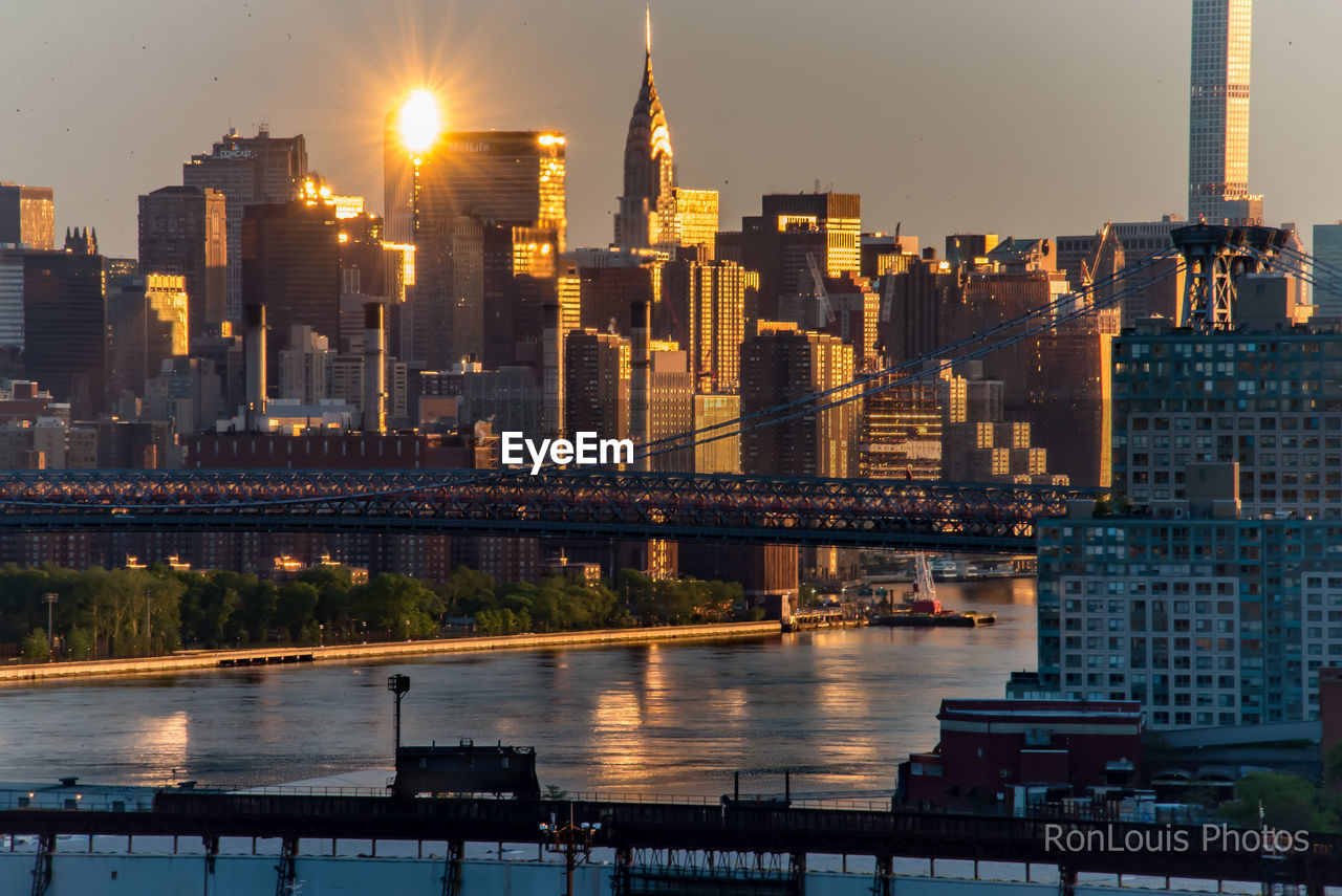 architecture, building exterior, built structure, city, water, river, illuminated, sky, building, office building exterior, cityscape, connection, bridge, skyscraper, nature, bridge - man made structure, no people, transportation, outdoors, tall - high, modern, financial district