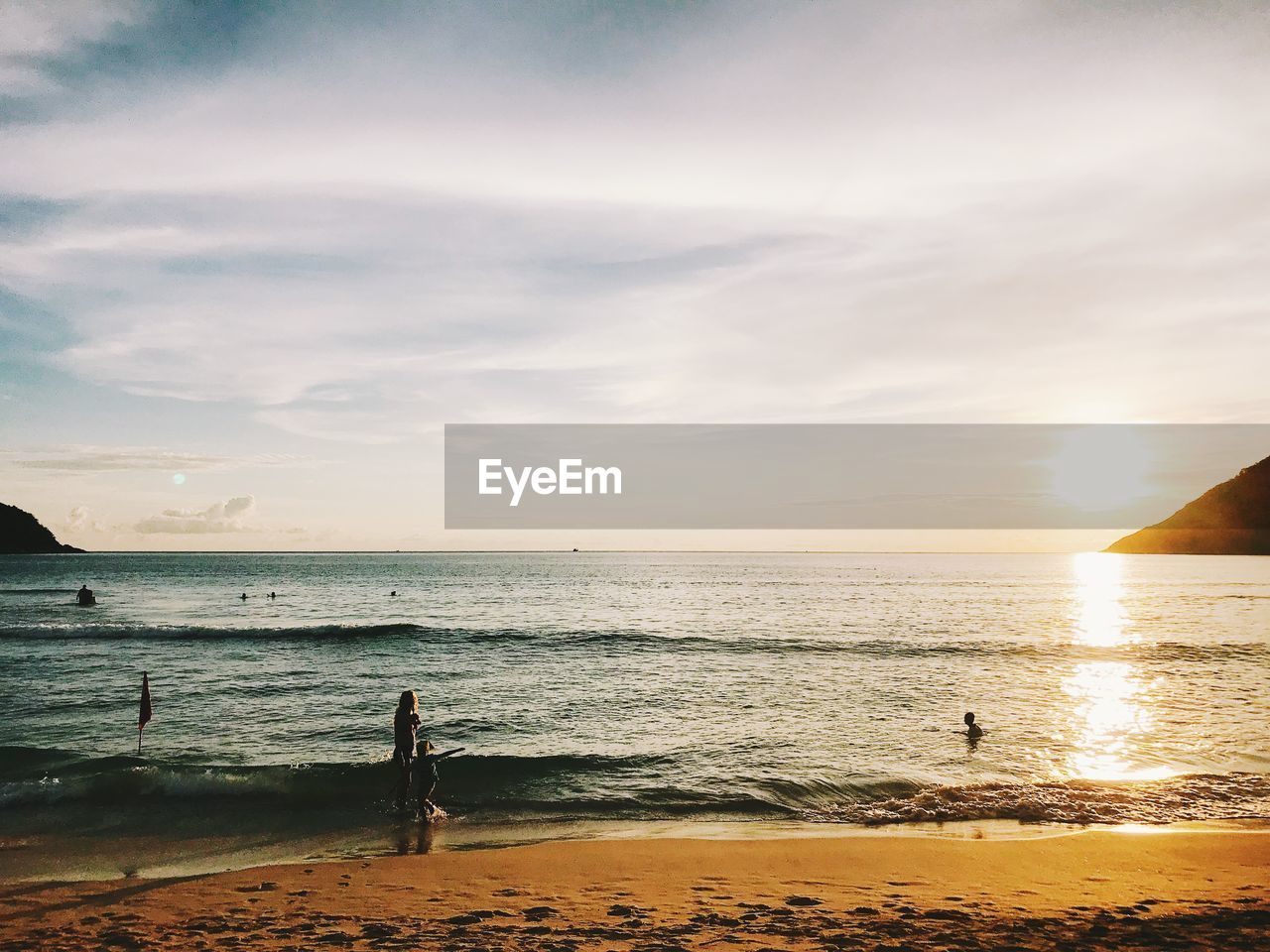 water, sky, sea, beauty in nature, beach, scenics - nature, horizon over water, horizon, sunset, land, real people, cloud - sky, tranquility, nature, one person, lifestyles, tranquil scene, leisure activity, non-urban scene, outdoors