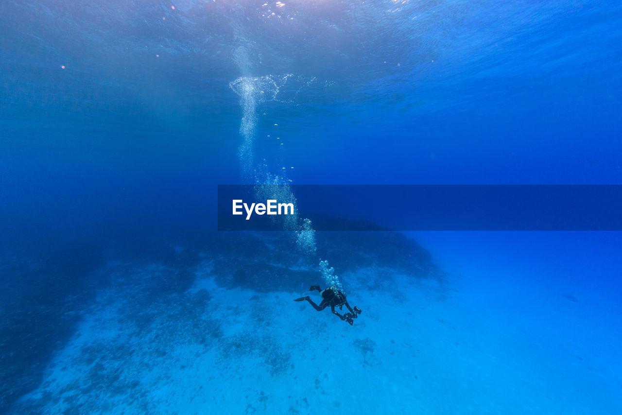 Woman Swimming Undersea