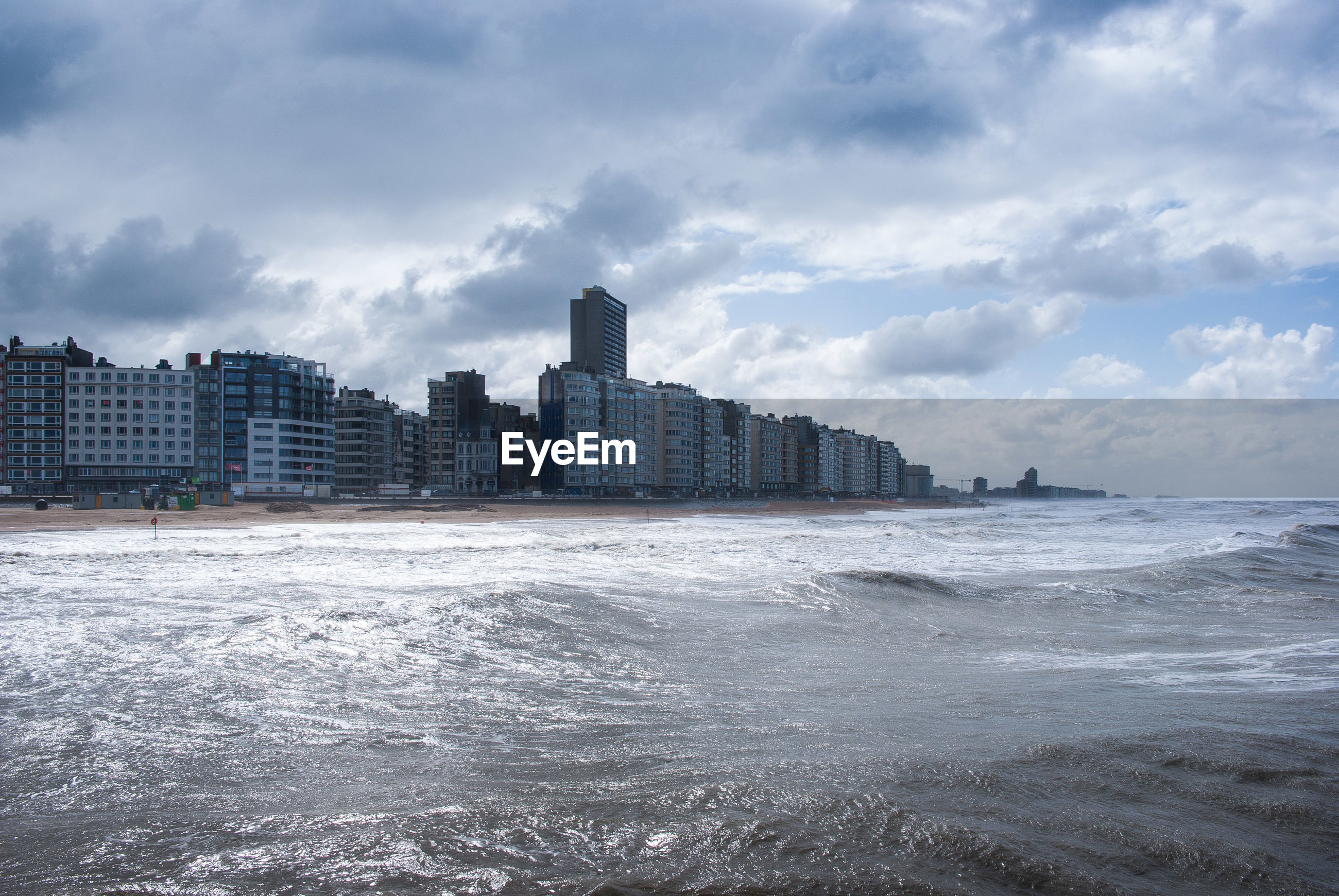 VIEW OF SEA WITH BUILDINGS IN BACKGROUND