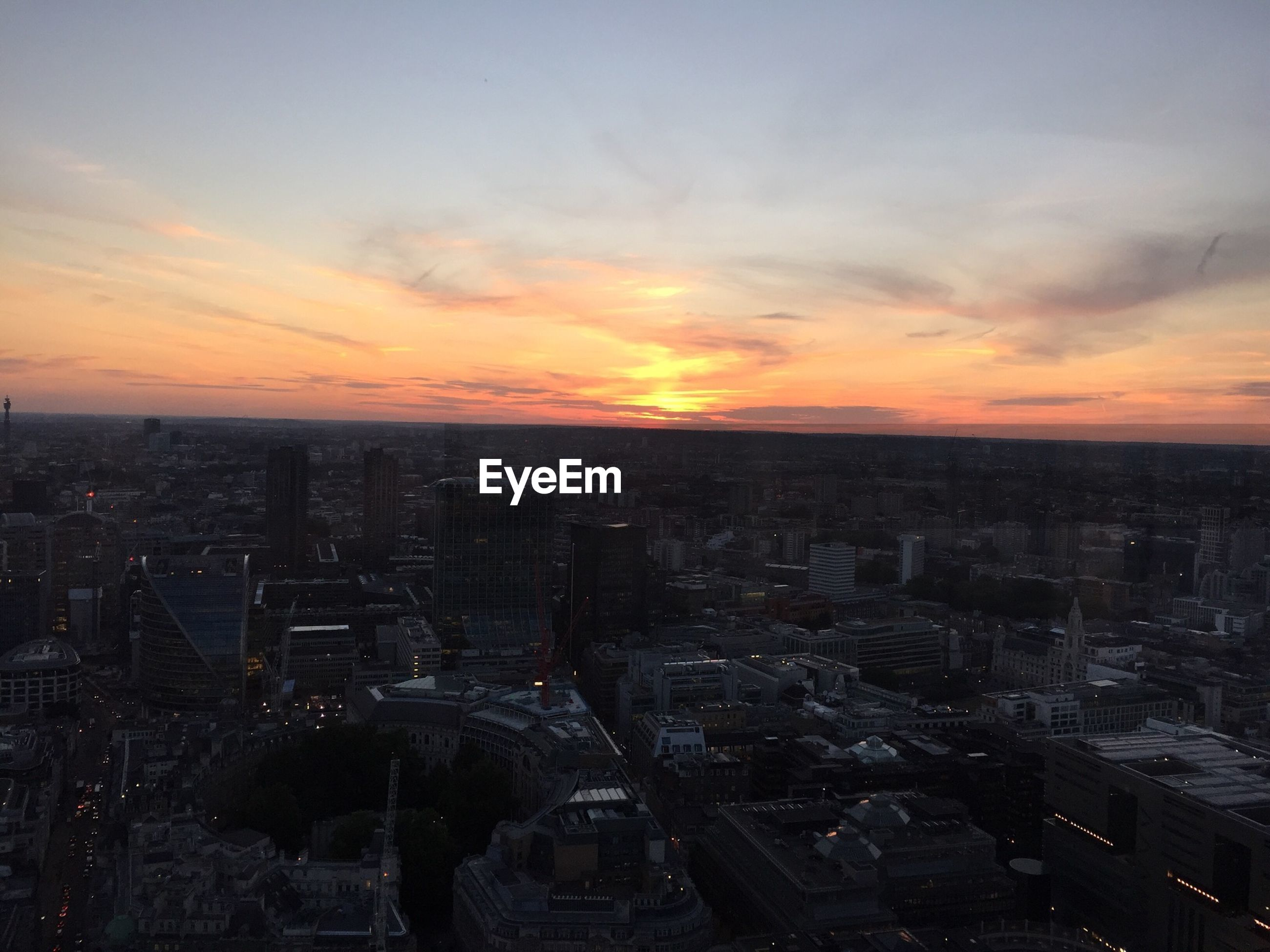 city, cityscape, sunset, building exterior, architecture, built structure, high angle view, crowded, orange color, sky, residential district, city life, residential building, skyscraper, cloud - sky, residential structure, tower, dusk, outdoors, no people