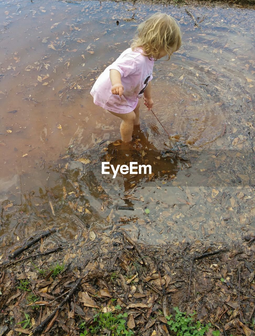 water, one person, full length, childhood, real people, standing, outdoors, ankle deep in water, day, boys, nature, blond hair, people