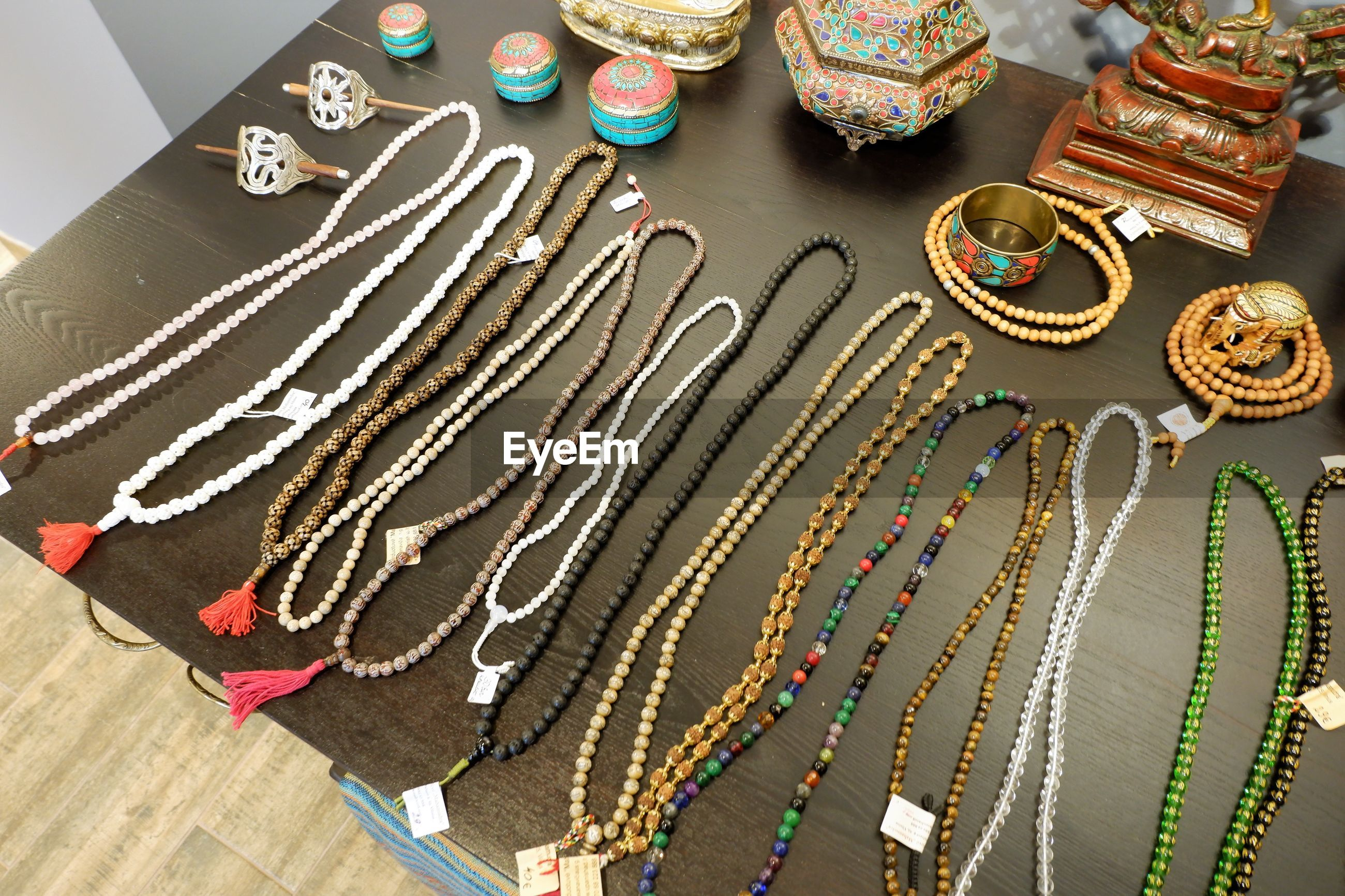 High angle view of multi colored jewelry on table