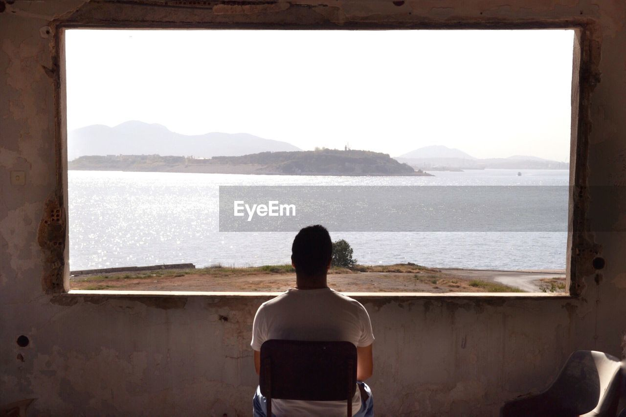 Rear view of man looking at beach