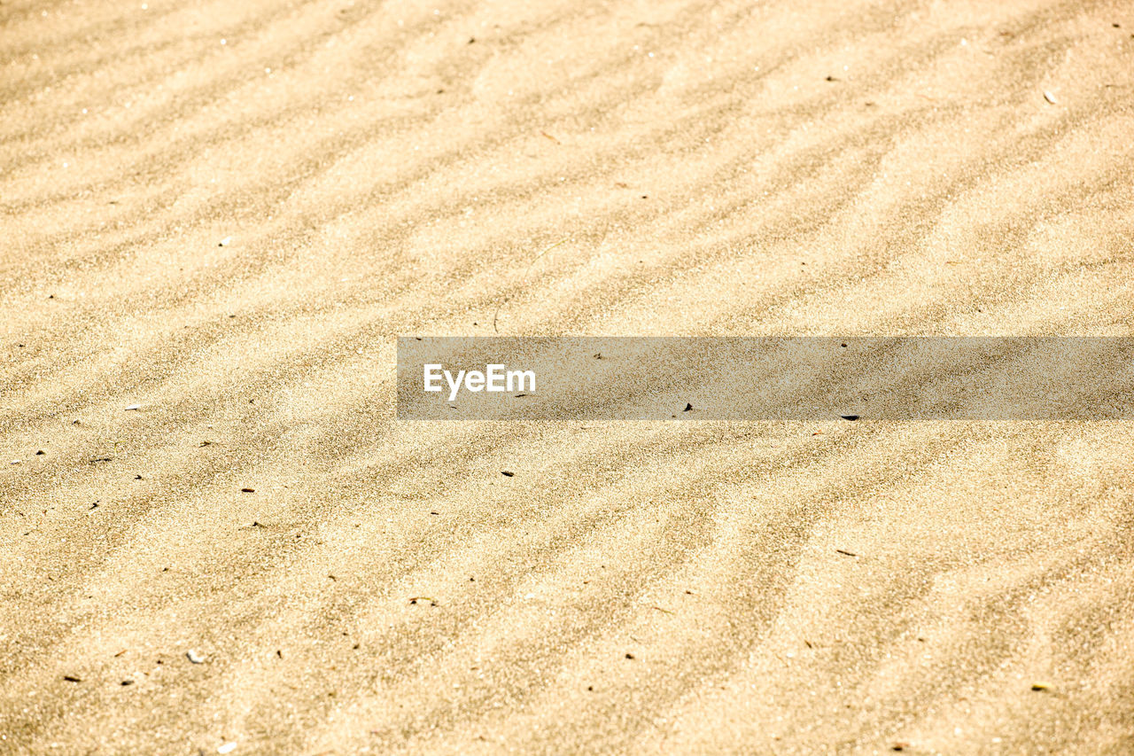 sand, land, beach, pattern, full frame, backgrounds, nature, high angle view, no people, textured, tranquility, day, beige, outdoors, brown, beauty in nature, natural pattern, wave pattern, landscape, water, arid climate