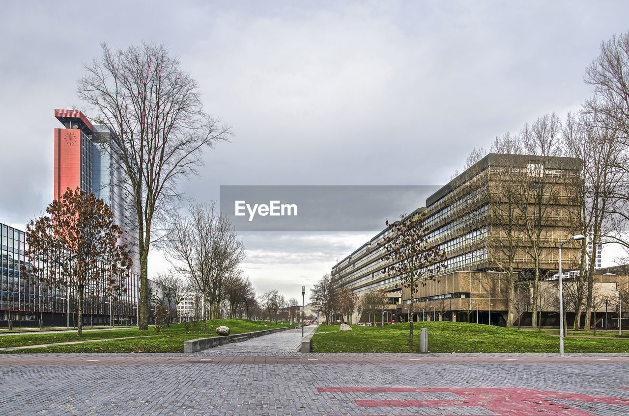 sky, architecture, built structure, plant, building exterior, nature, tree, cloud - sky, day, no people, bare tree, building, outdoors, grass, direction, empty, park, city, the way forward, field
