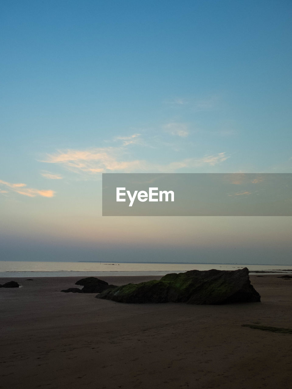 sea, beach, nature, scenics, tranquil scene, horizon over water, tranquility, beauty in nature, sand, water, sky, shore, sunset, outdoors, no people, landscape, blue, travel destinations, day