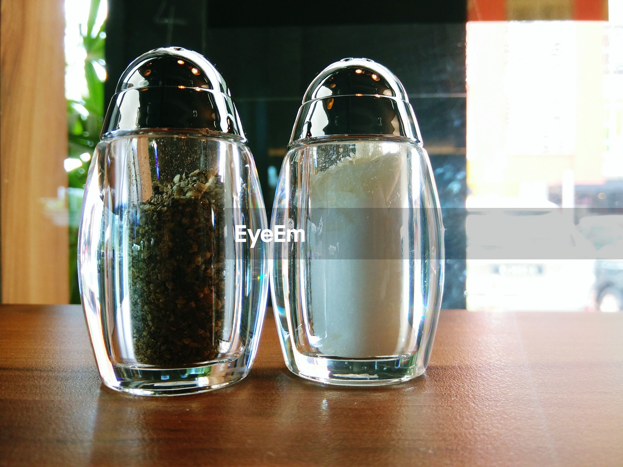 Salt and pepper shakers on table at restaurant