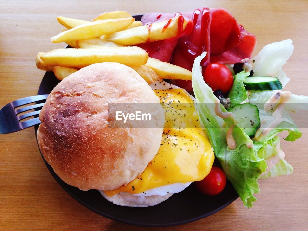 Burger With Fried Egg, French Fries And Salad