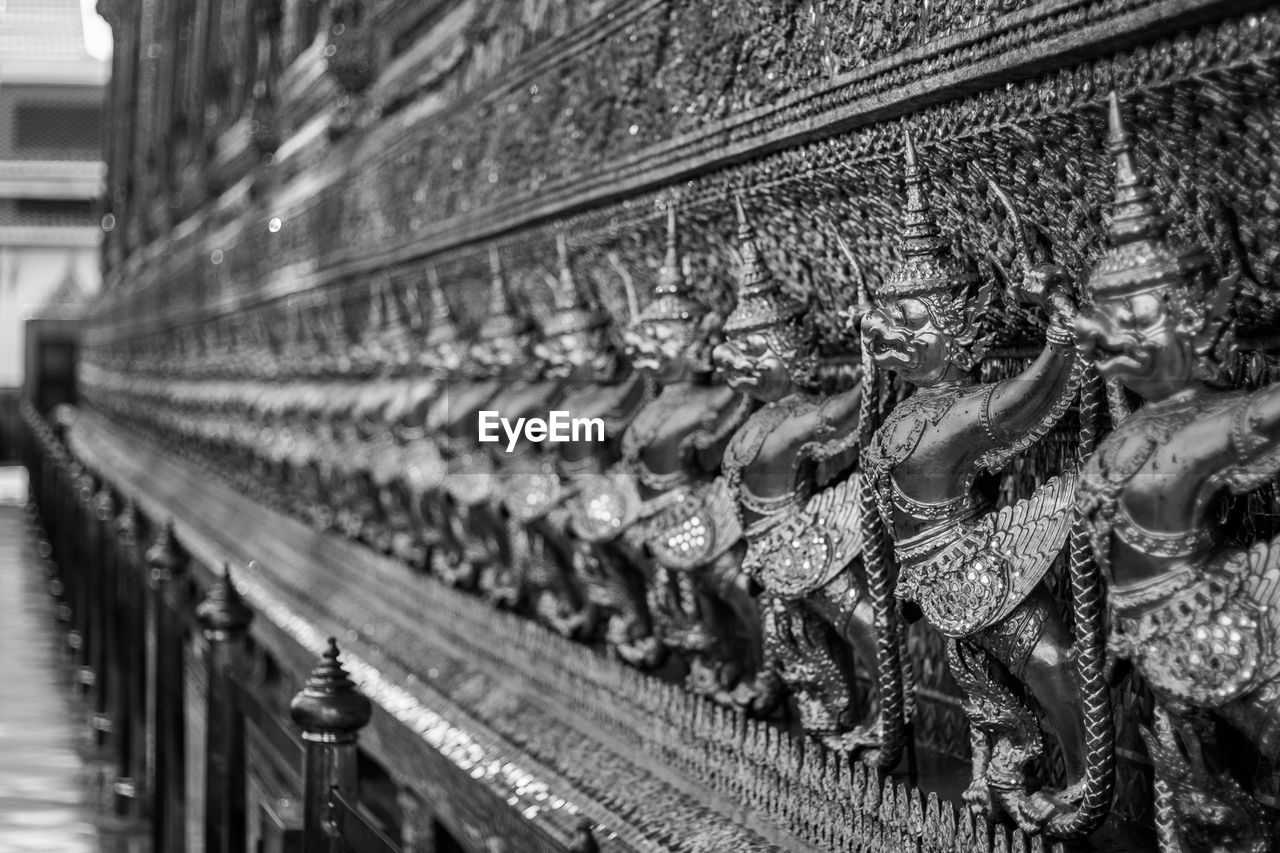 belief, no people, spirituality, religion, in a row, architecture, close-up, built structure, focus on foreground, indoors, history, place of worship, metal, the past, order, selective focus, human representation, creativity, high angle view, art and craft, antique