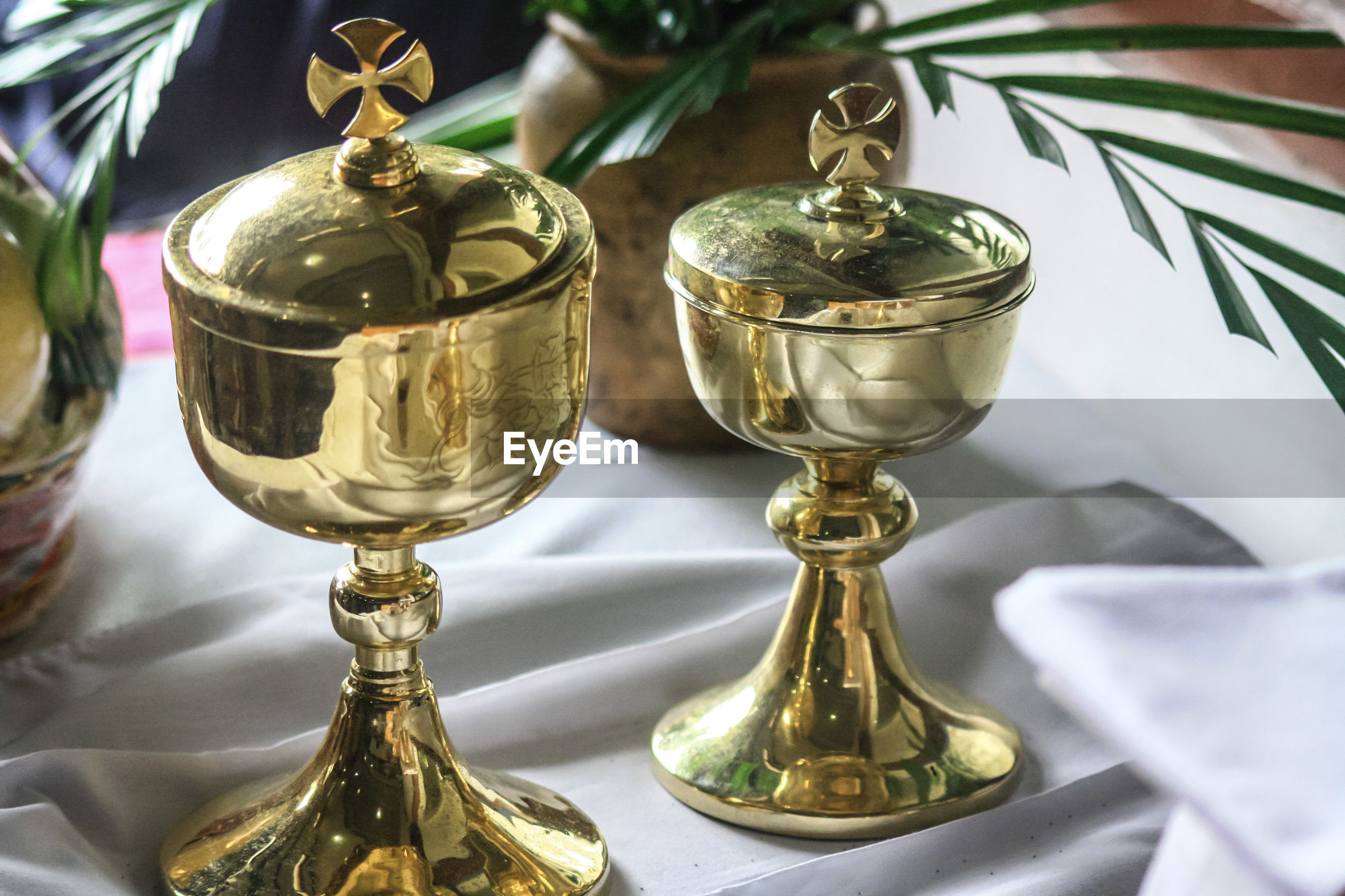 High angle view of communion cups on table