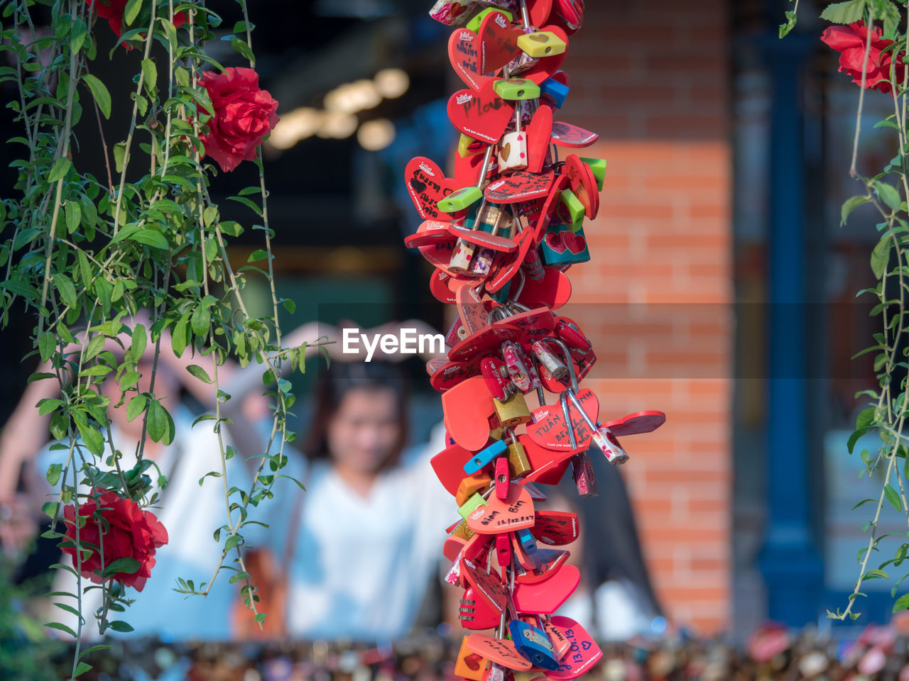day, focus on foreground, representation, red, decoration, outdoors, childhood, celebration, art and craft, lifestyles, real people, multi colored, festival, men, creativity, people, hanging, chinese new year