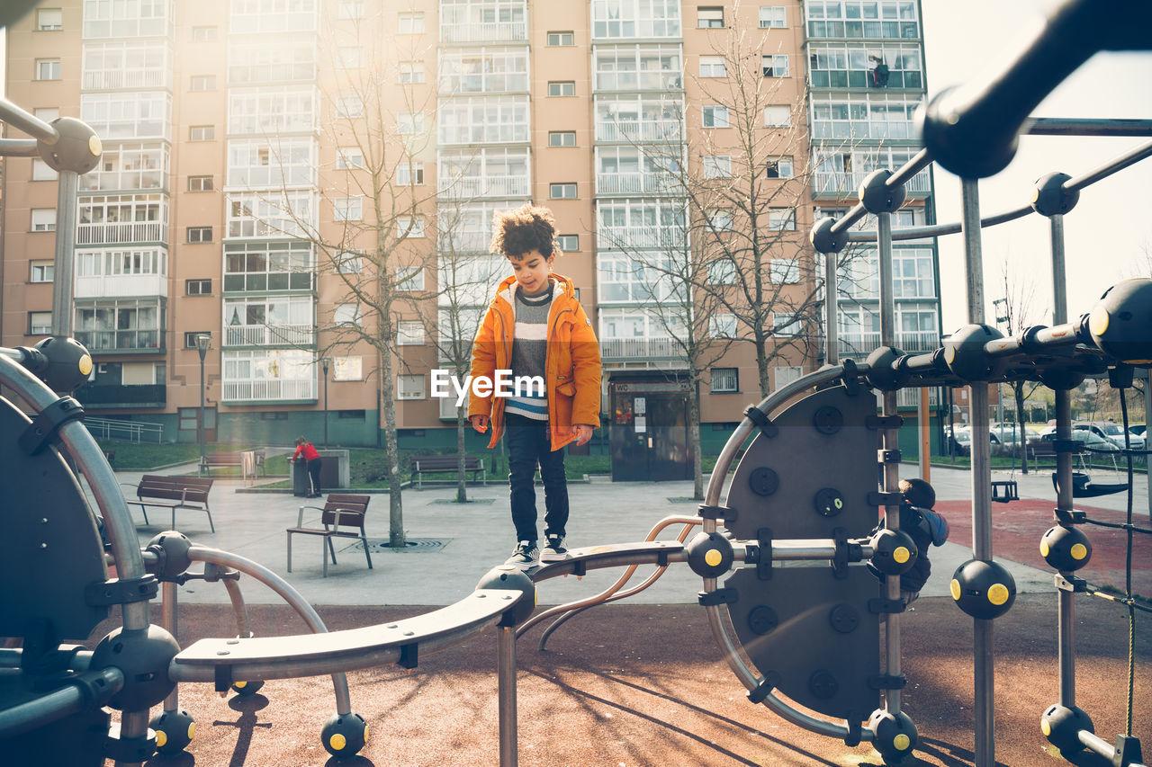 Cute Boy Enjoying In Playground