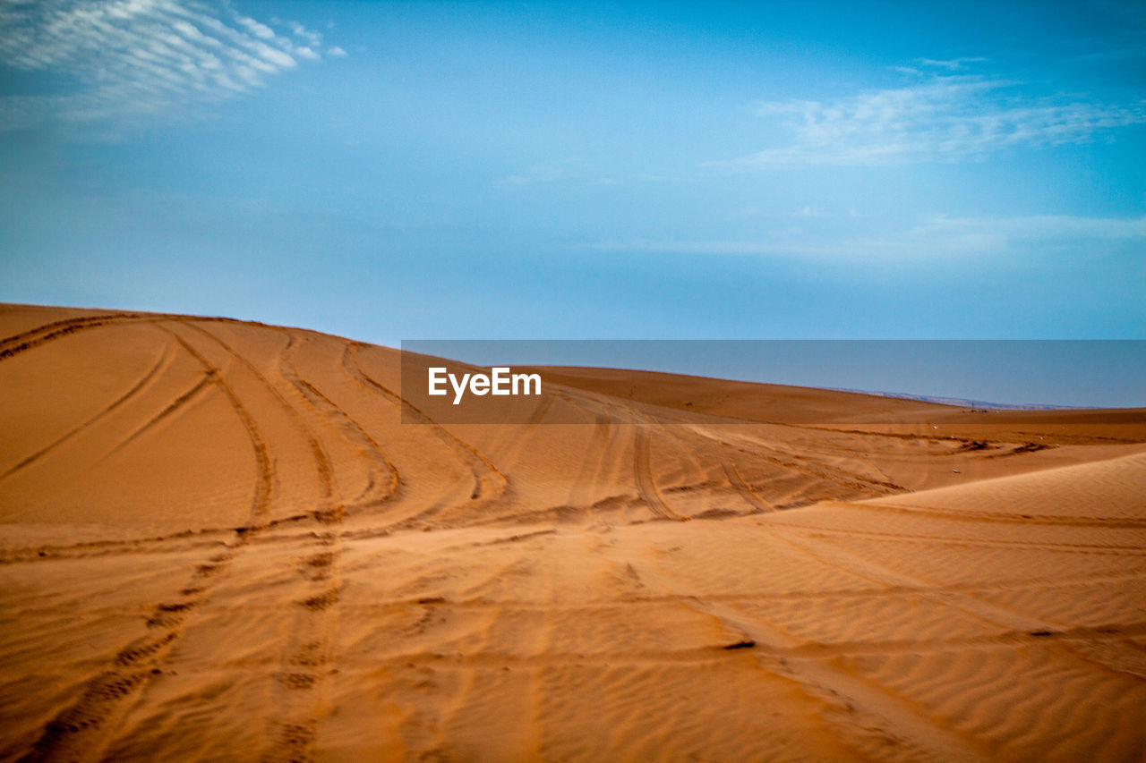 sand, sky, landscape, land, sand dune, scenics - nature, desert, environment, climate, arid climate, tranquil scene, non-urban scene, nature, tranquility, cloud - sky, beauty in nature, no people, horizon over land, day, remote, outdoors
