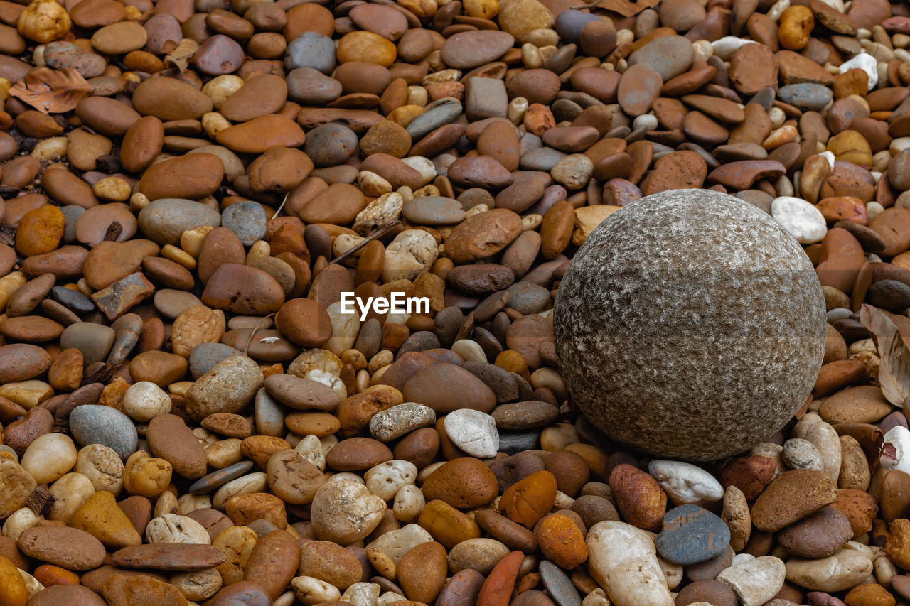 stone - object, stone, rock, pebble, abundance, large group of objects, solid, food and drink, full frame, no people, backgrounds, food, high angle view, freshness, close-up, nature, rock - object, still life, brown, variation