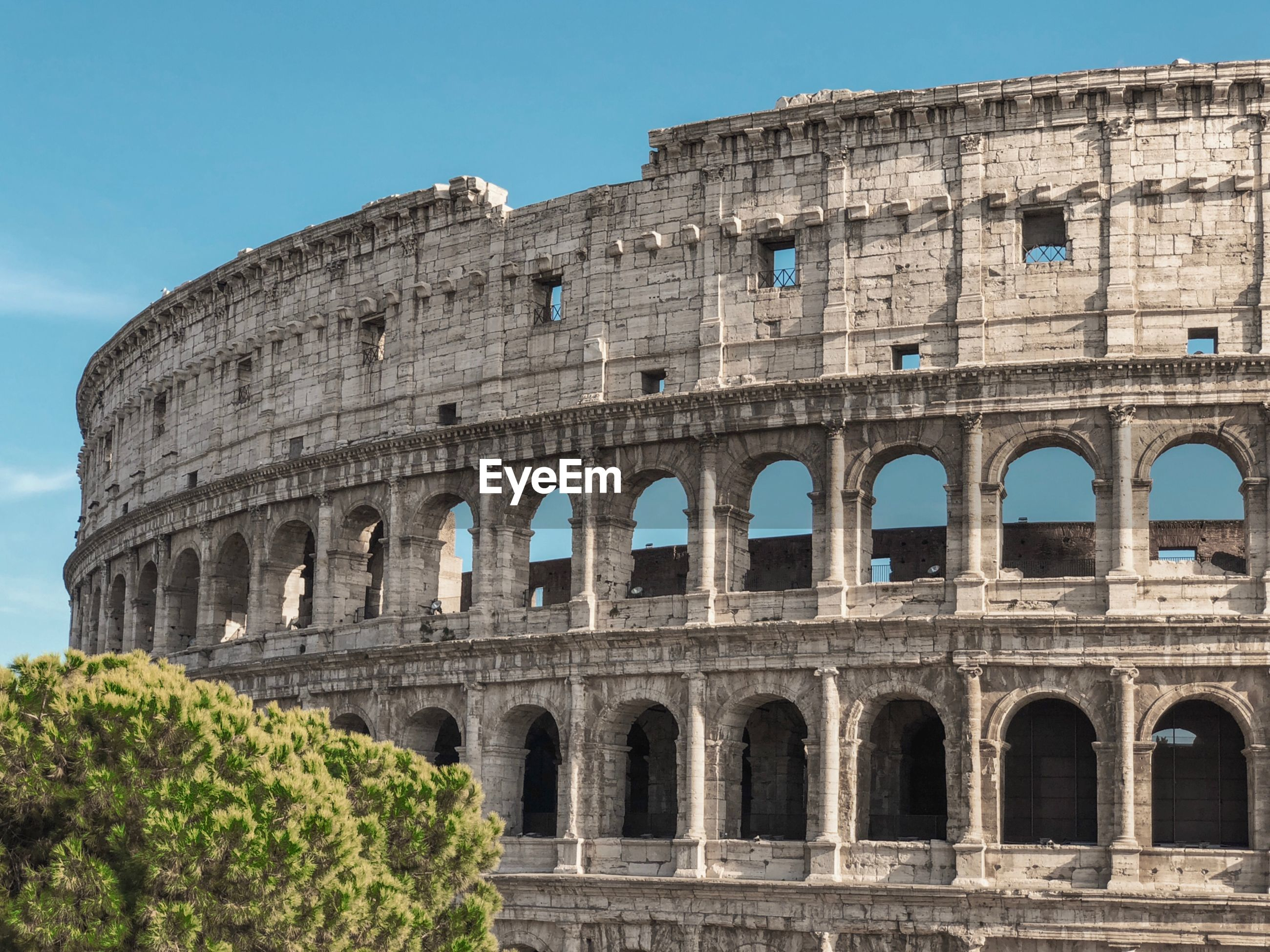Coliseum against sky during sunny day