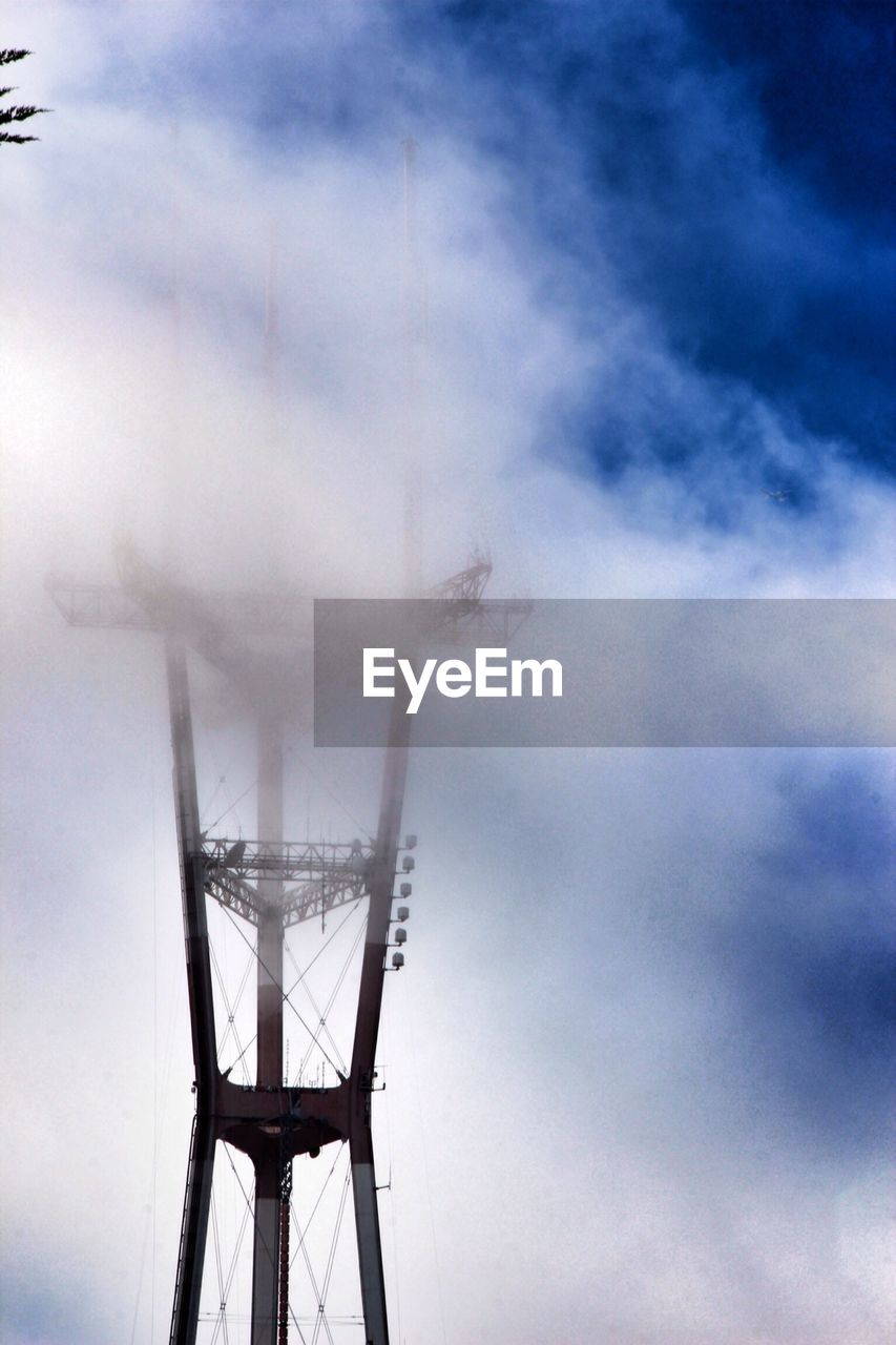 Sutro tower against cloudy sky