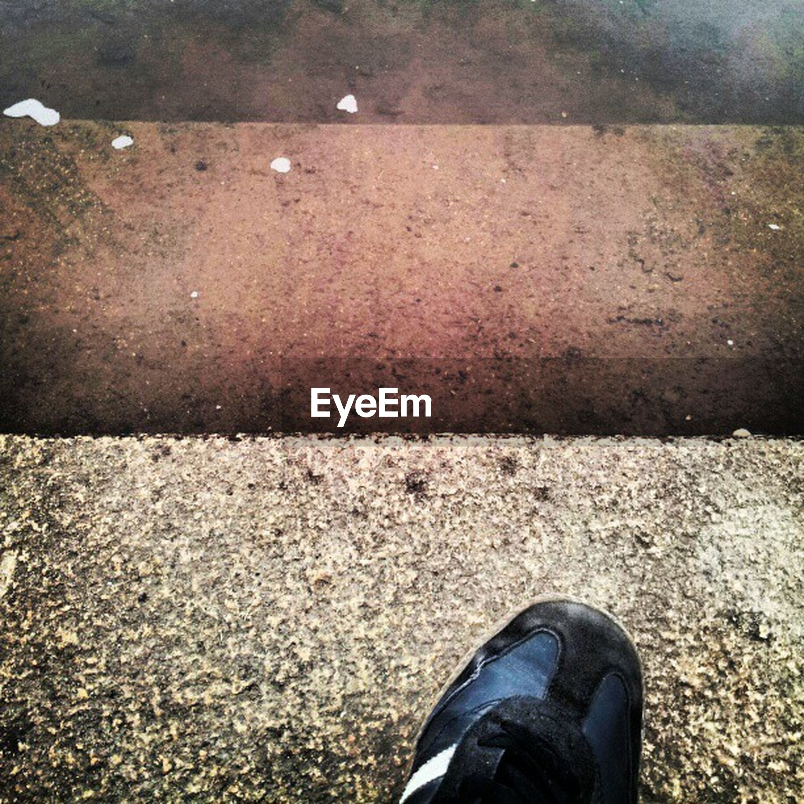 low section, shoe, person, personal perspective, footwear, standing, high angle view, human foot, jeans, part of, street, directly above, lifestyles, unrecognizable person, asphalt, close-up, men