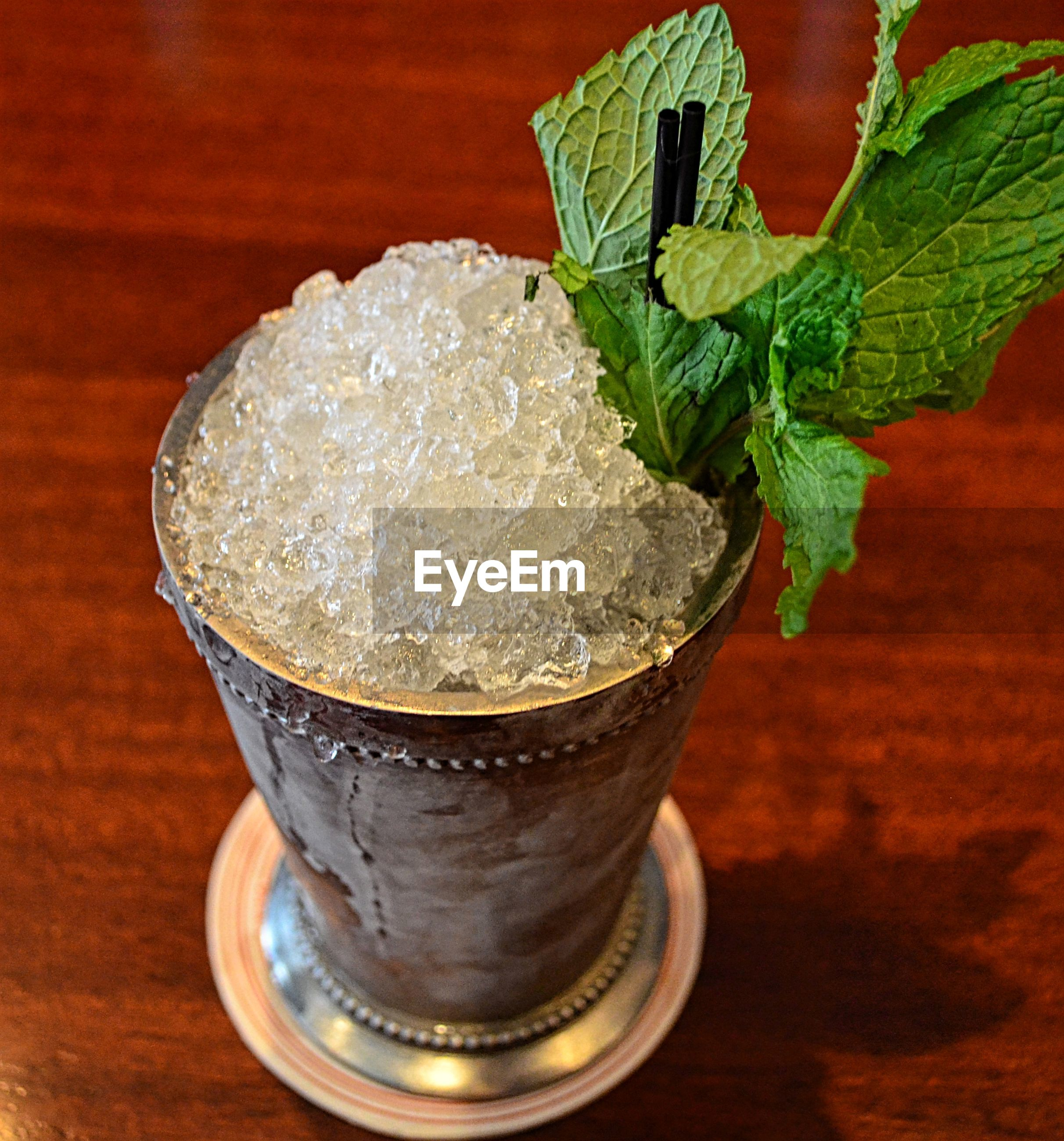 Close-up of mint julep served on table