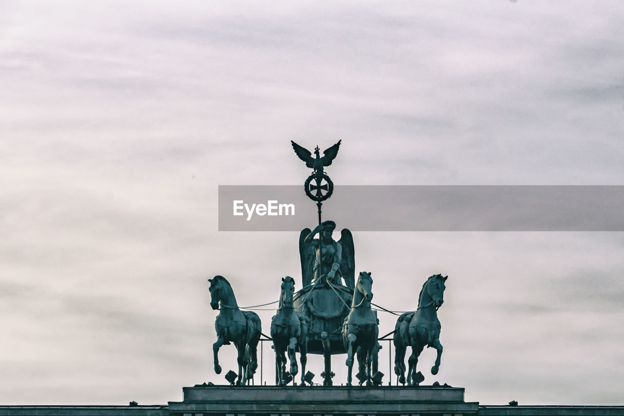 sky, cloud - sky, representation, sculpture, art and craft, architecture, mammal, no people, creativity, statue, nature, day, animal wildlife, history, human representation, built structure, the past, outdoors