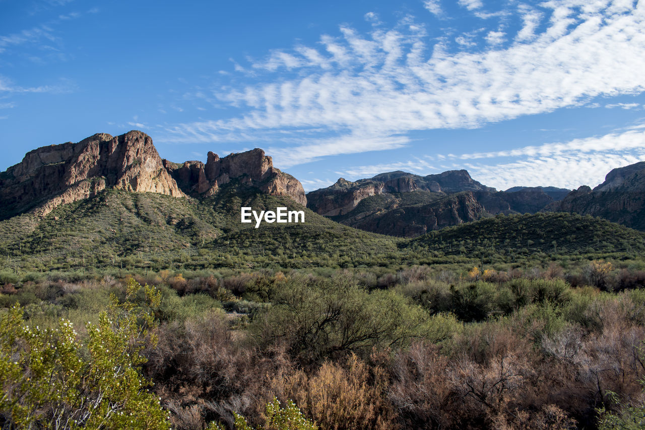 sky, environment, scenics - nature, beauty in nature, tranquil scene, landscape, plant, tranquility, cloud - sky, mountain, non-urban scene, nature, land, rock, remote, no people, rock formation, mountain range, day, rock - object, outdoors, formation, arid climate, climate, eroded, mountain peak