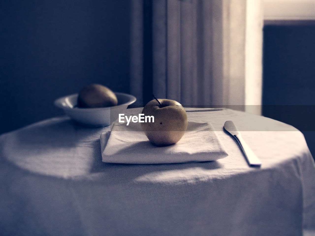 Close-Up Of Apple On Napkin At Table