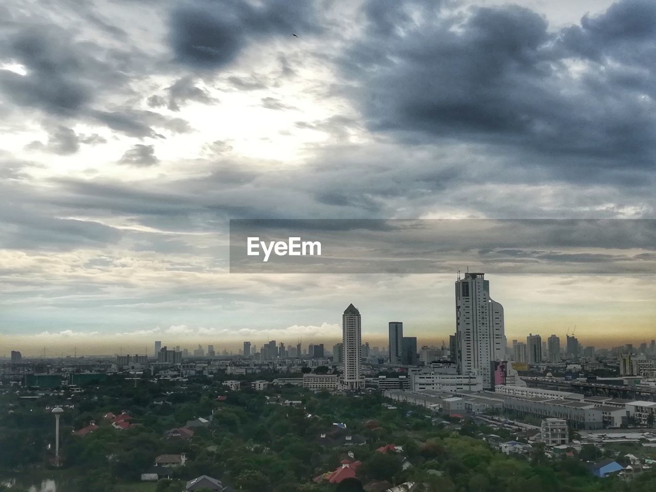 architecture, city, skyscraper, built structure, cityscape, building exterior, modern, sky, cloud - sky, tower, travel destinations, urban skyline, downtown district, outdoors, sunset, no people, downtown, day