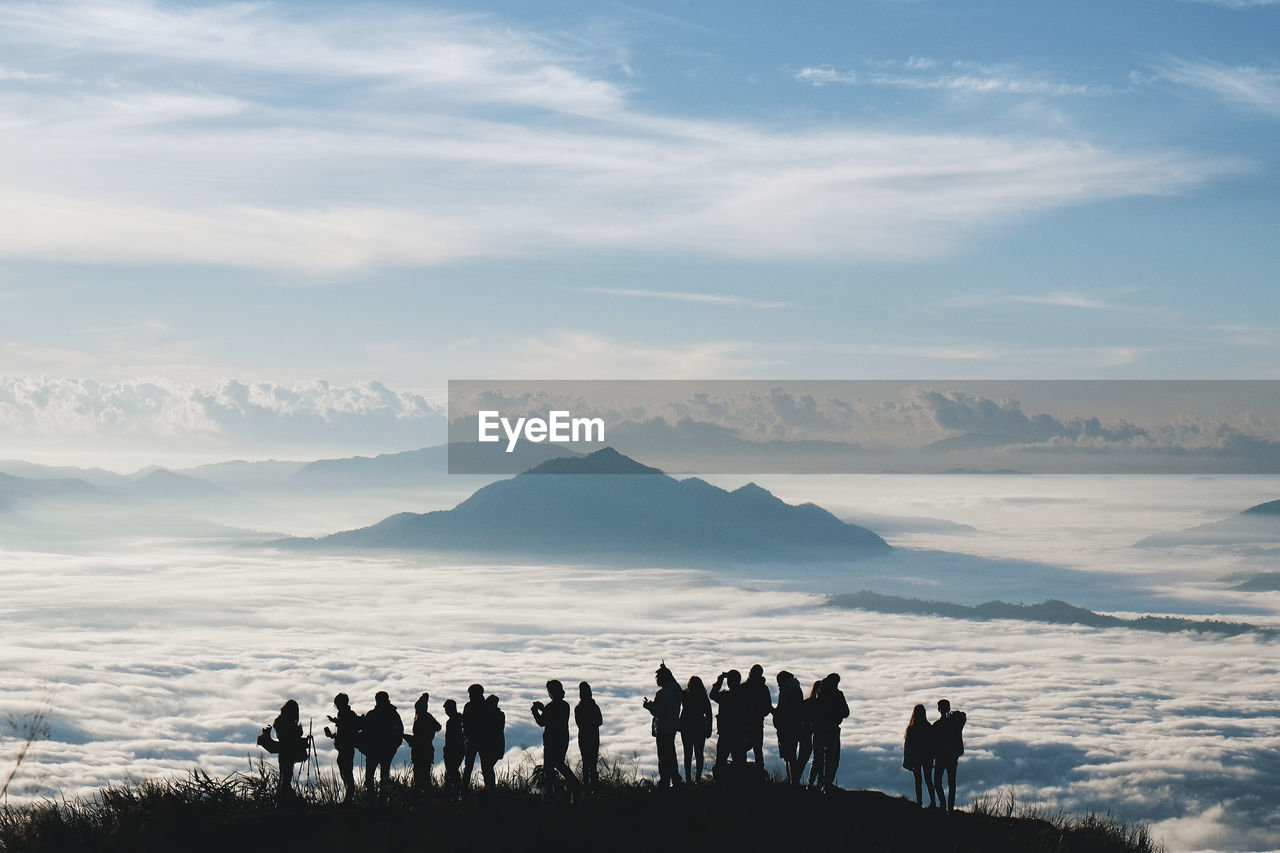 silhouette, real people, sky, scenics, nature, beauty in nature, mountain, large group of people, outdoors, cloud - sky, lifestyles, men, togetherness, day, landscape, sunset, women, domestic animals, mammal, people
