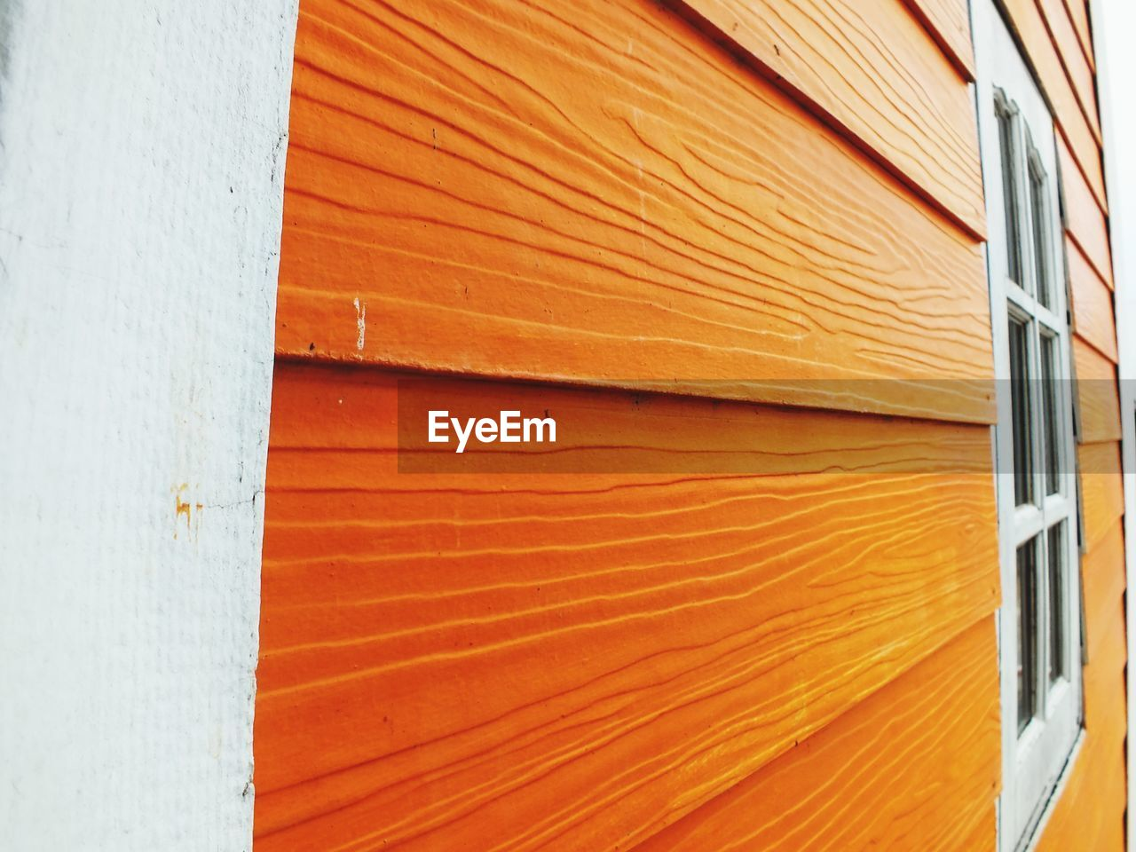orange color, no people, full frame, close-up, backgrounds, pattern, wall - building feature, built structure, architecture, wood - material, textured, white color, day, building exterior, outdoors, security, detail, protection, wall, metal