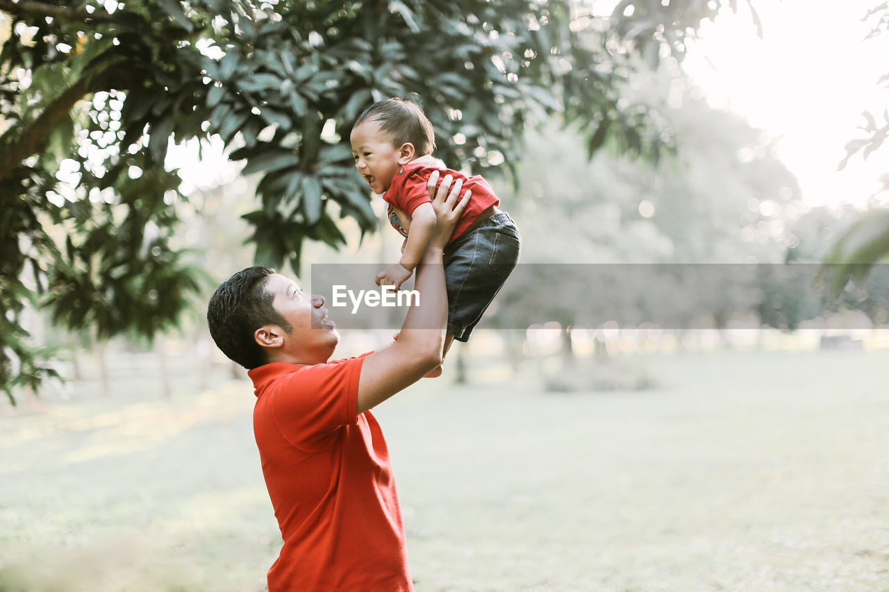 Father Playing With Son At Public Park