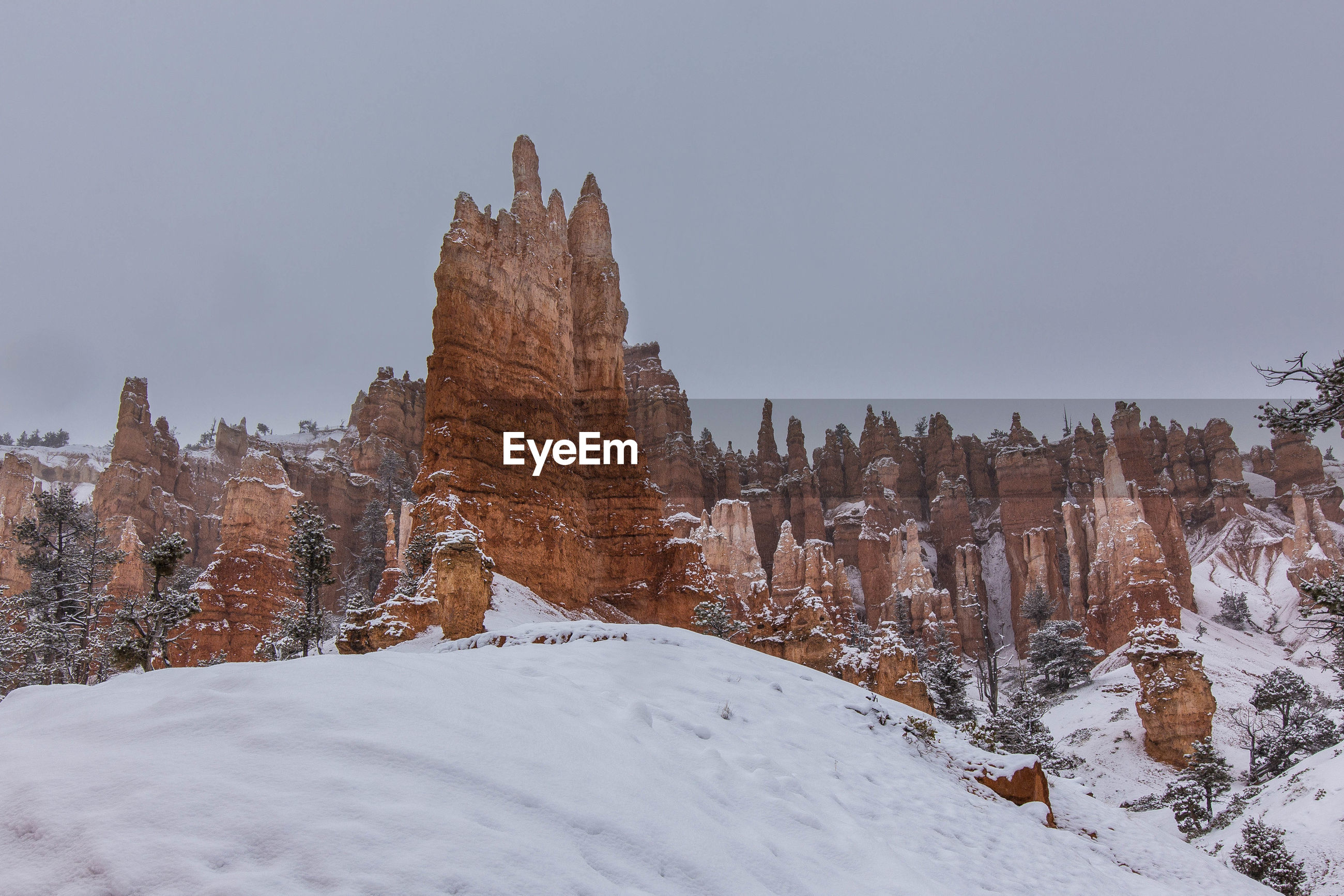 Scenic view of rock formations against sky during winter