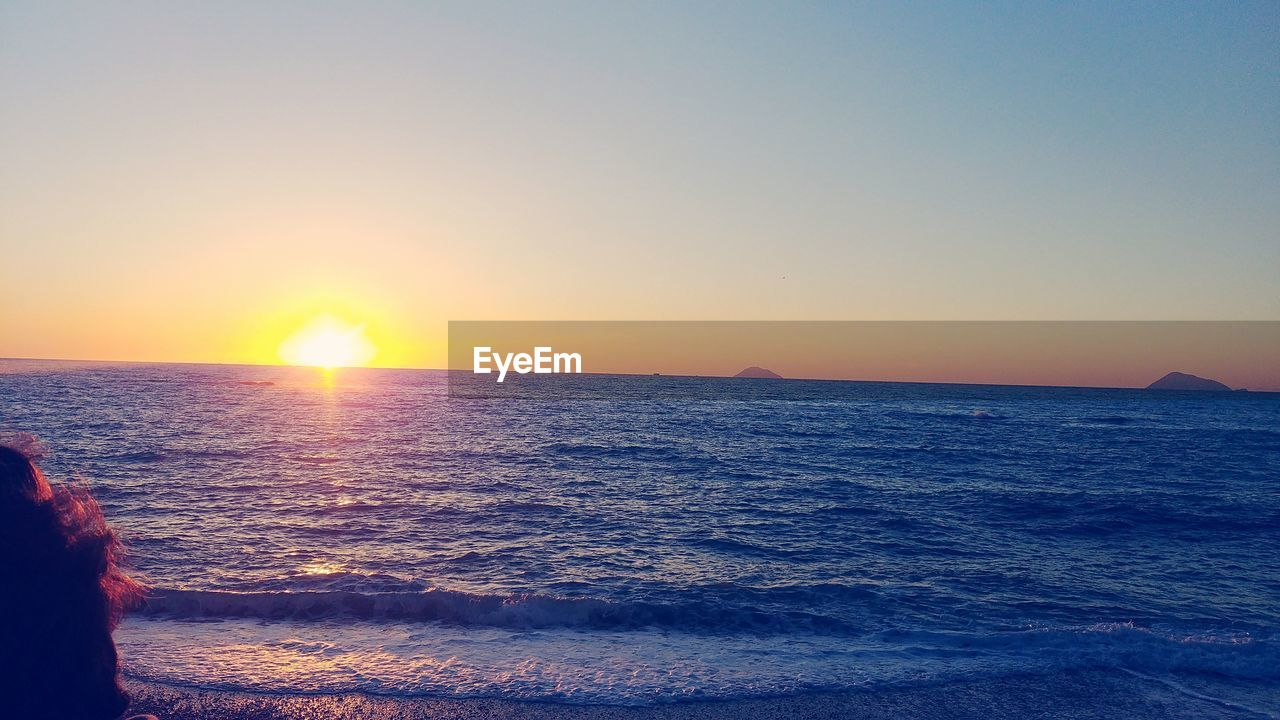 sky, sea, water, sunset, scenics - nature, beauty in nature, horizon over water, horizon, tranquility, tranquil scene, sun, idyllic, sunlight, clear sky, beach, land, nature, non-urban scene, copy space, outdoors, lens flare, bright
