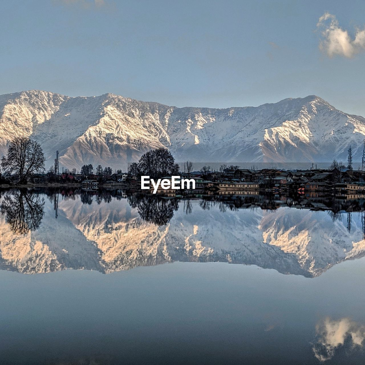 mountain, reflection, water, scenics - nature, sky, beauty in nature, cold temperature, mountain range, lake, tranquility, waterfront, winter, tranquil scene, nature, snow, snowcapped mountain, no people, symmetry, outdoors