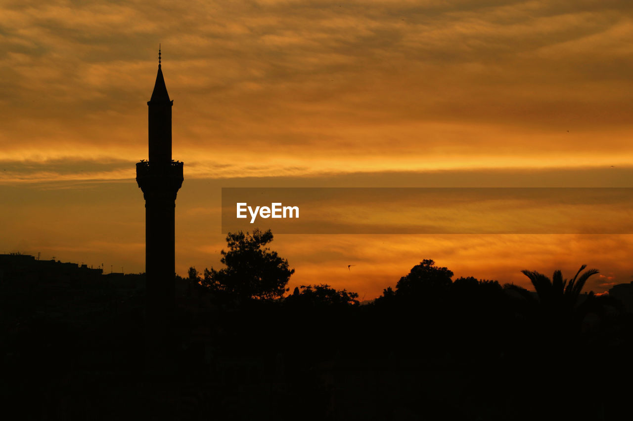 sunset, sky, silhouette, orange color, cloud - sky, architecture, beauty in nature, built structure, no people, building exterior, tree, plant, nature, tower, building, scenics - nature, tourism, outdoors, idyllic, religion, spire